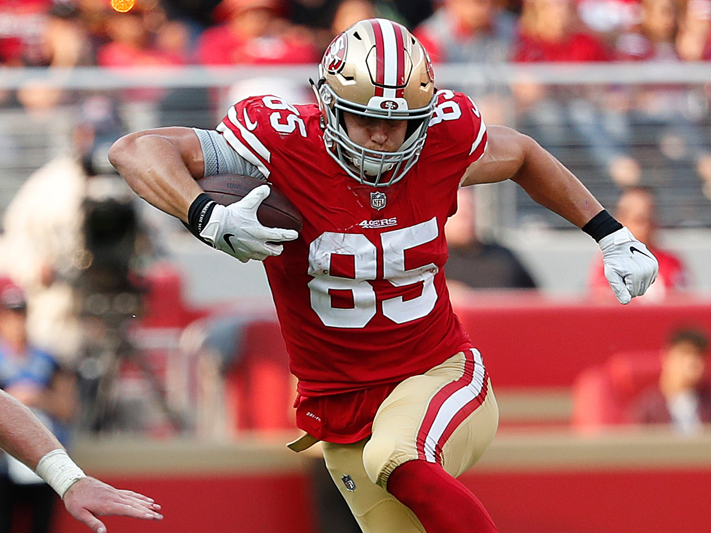 San Francisco 49ers tight end George Kittle (85) runs against Arizona Cardinals safety Budda Baker, bottom, during the second half of an NFL football game in Santa Clara, Calif., Sunday, Oct. 7, 2018.