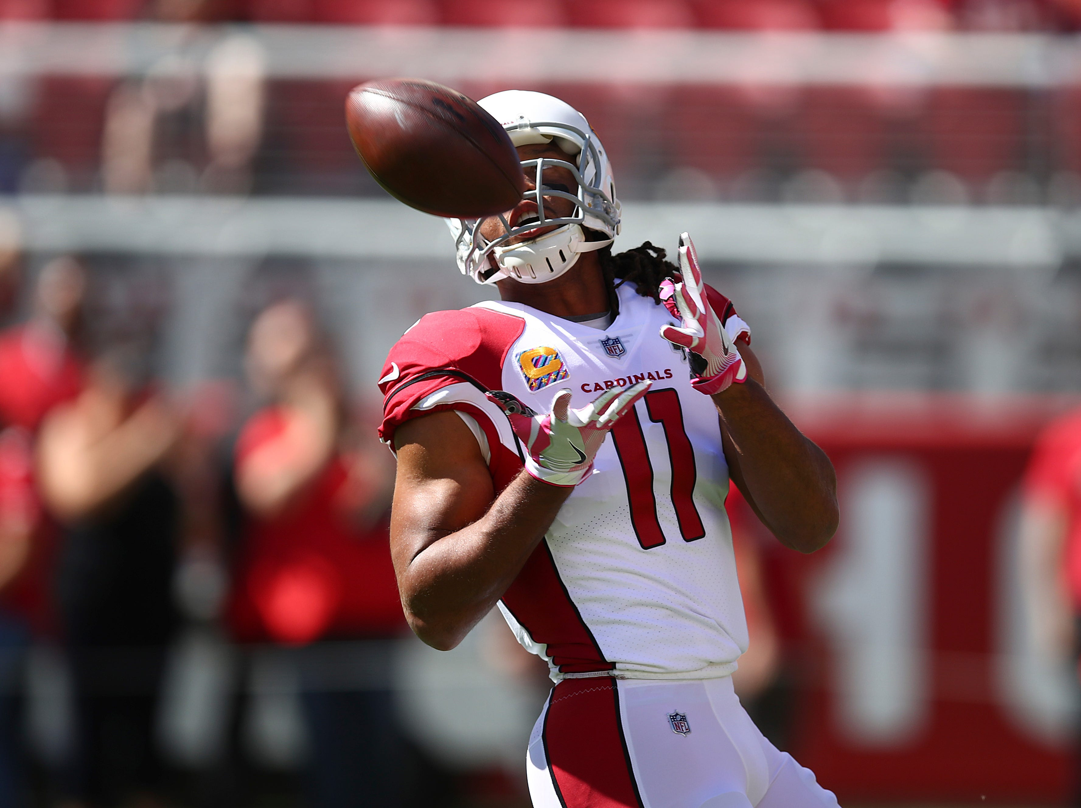 Arizona Cardinals wide receiver Larry Fitzgerald (11) warms up before an NFL football game against the San Francisco 49ers in Santa Clara, Calif., Sunday, Oct. 7, 2018.