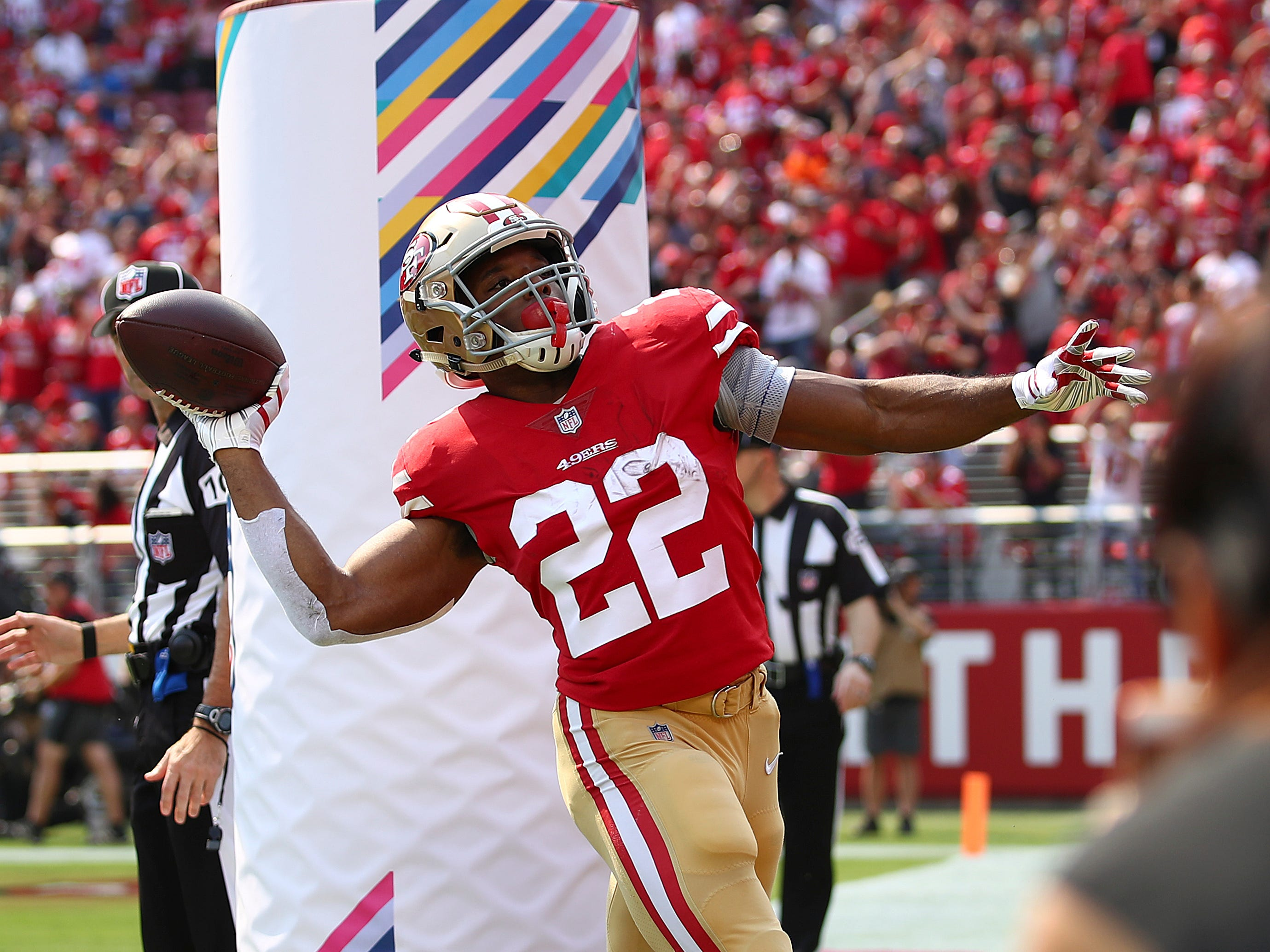 San Francisco 49ers running back Matt Breida (22) celebrates after scoring a touchdown against the Arizona Cardinals during the first half of an NFL football game in Santa Clara, Calif., Sunday, Oct. 7, 2018.