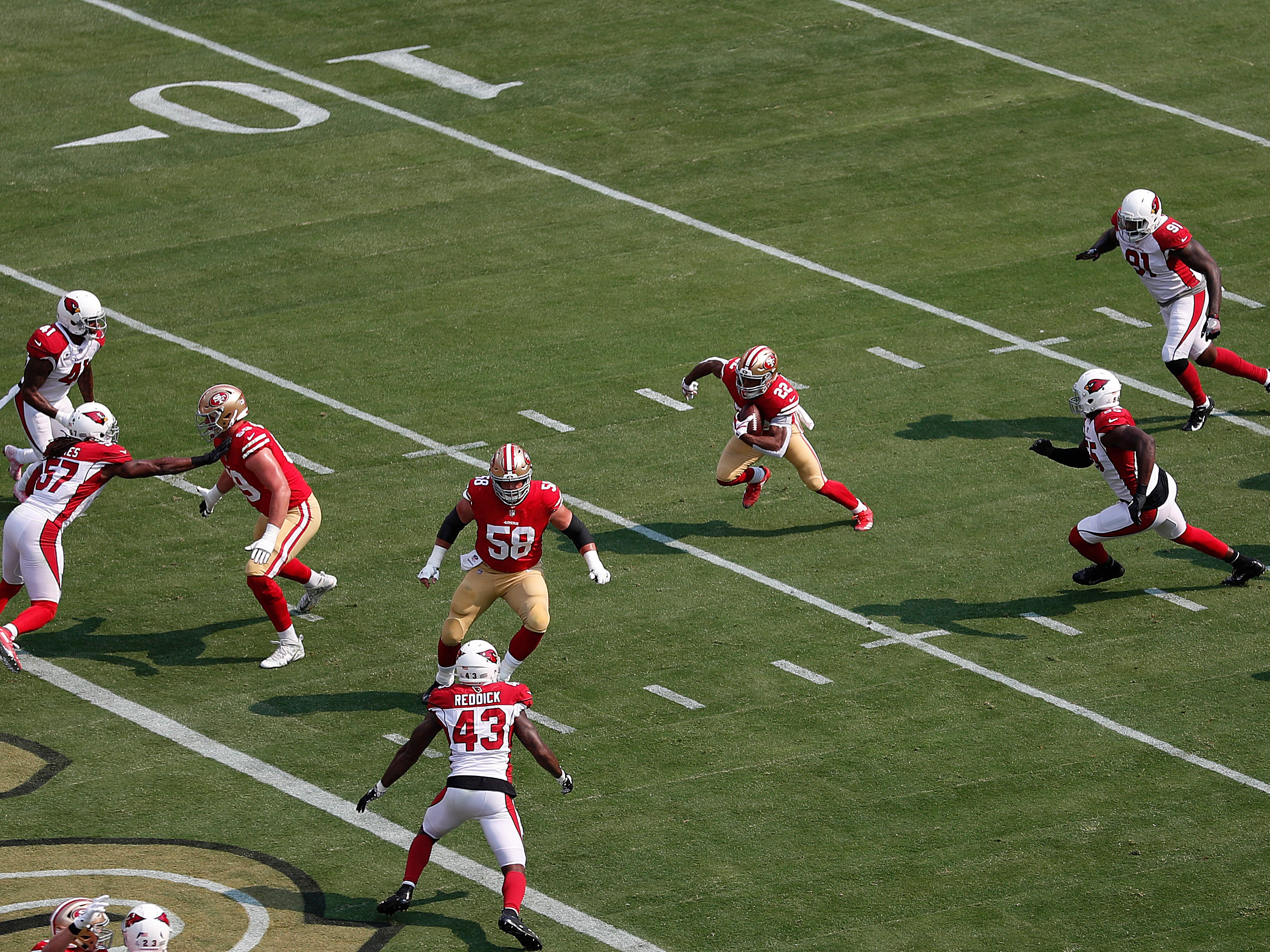 San Francisco 49ers running back Matt Breida (22) runs toward the end zone to score on a touchdown reception against the Arizona Cardinals during the first half of an NFL football game in Santa Clara, Calif., Sunday, Oct. 7, 2018.