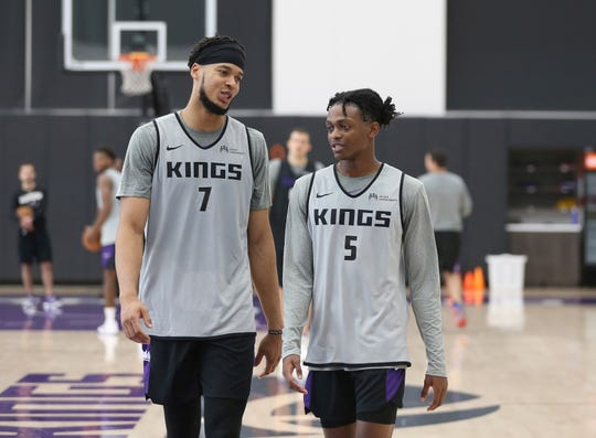 Sacramento Kings' Skal Labissiere, left, and De'Aaron Fox talk during training camp at the teams practice facility Wednesday, Sept. 26, 2018, in Sacramento, Calif. (AP Photo/Rich Pedroncelli)