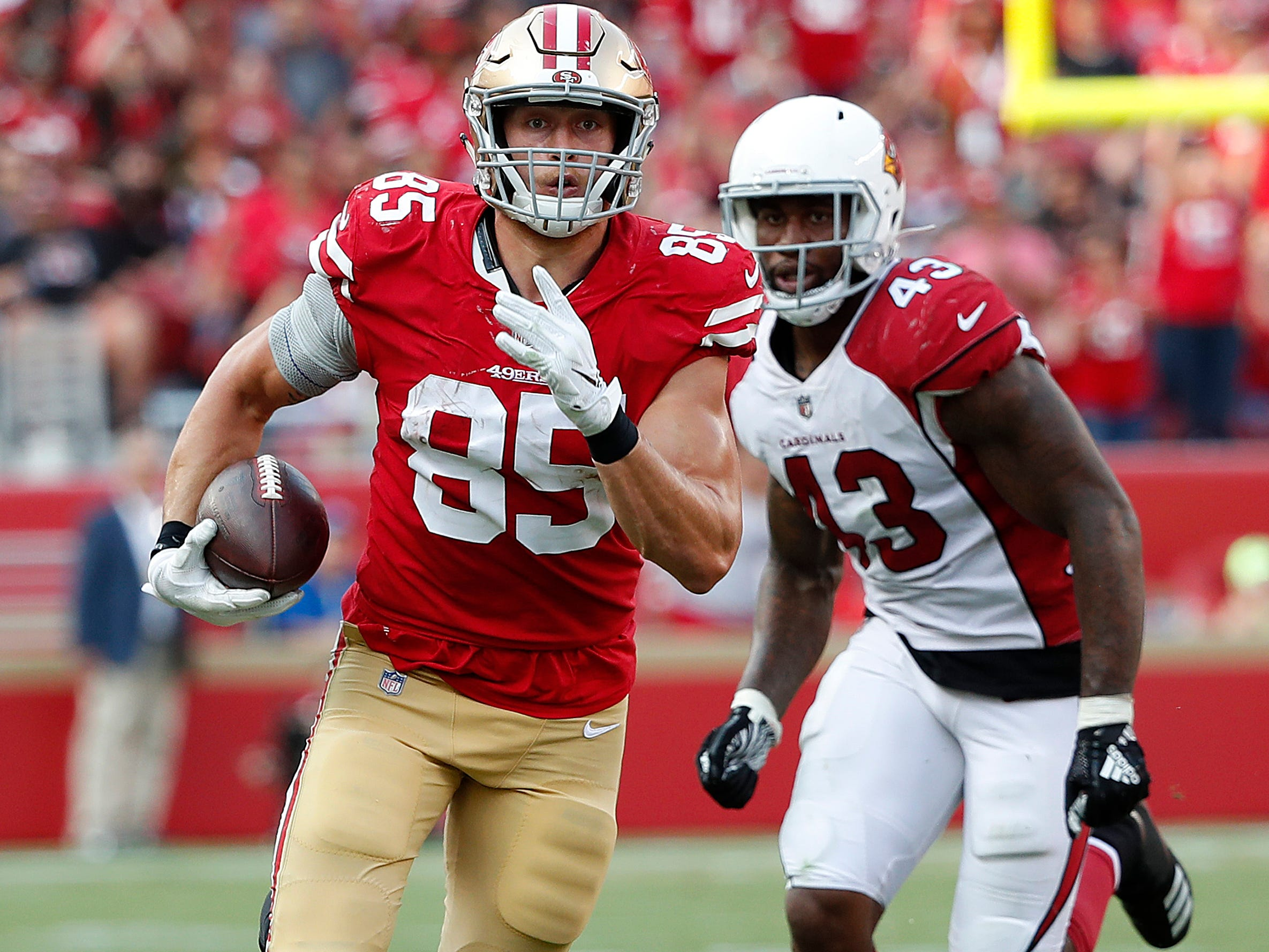 San Francisco 49ers tight end George Kittle (85) runs in front of Arizona Cardinals linebacker Haason Reddick (43) during the second half of an NFL football game in Santa Clara, Calif., Sunday, Oct. 7, 2018.