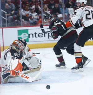 Ducks John Gibson (36) makes a save on a shot from Coyotes Dylan Strome (20) during the second period at Gila River Arena in Glendale, Ariz. on October 6, 2018.