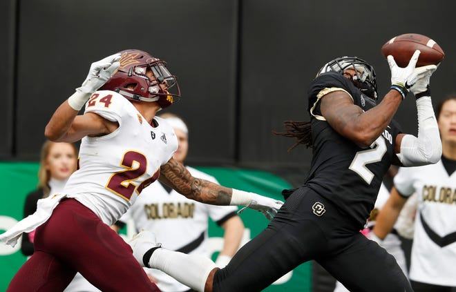 Colorado wide receiver Laviska Shenault Jr., right, pulls in a pass for a touchdown as Arizona State defensive back Chase Lucas covers in the second half of an NCAA college football game Saturday, Oct. 6, 2018, in Boulder, Colo. Colorado won 28-21. (AP Photo/David Zalubowski)