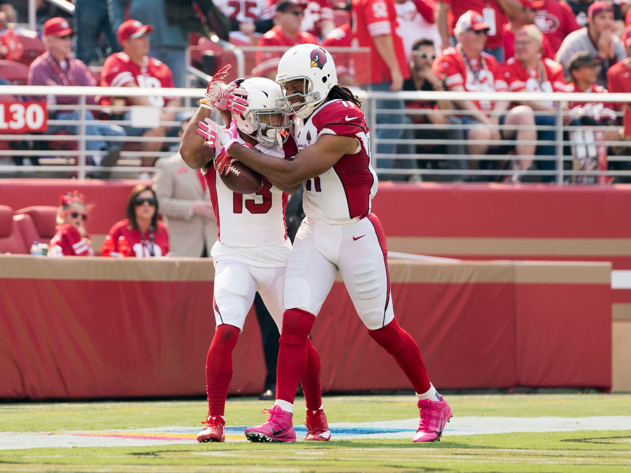 October 7, 2018; Santa Clara, CA, USA; Arizona Cardinals wide receiver Christian Kirk (13) is congratulated by wide receiver Larry Fitzgerald (11) for scoring a touchdown against the San Francisco 49ers during the first quarter at Levi's Stadium.