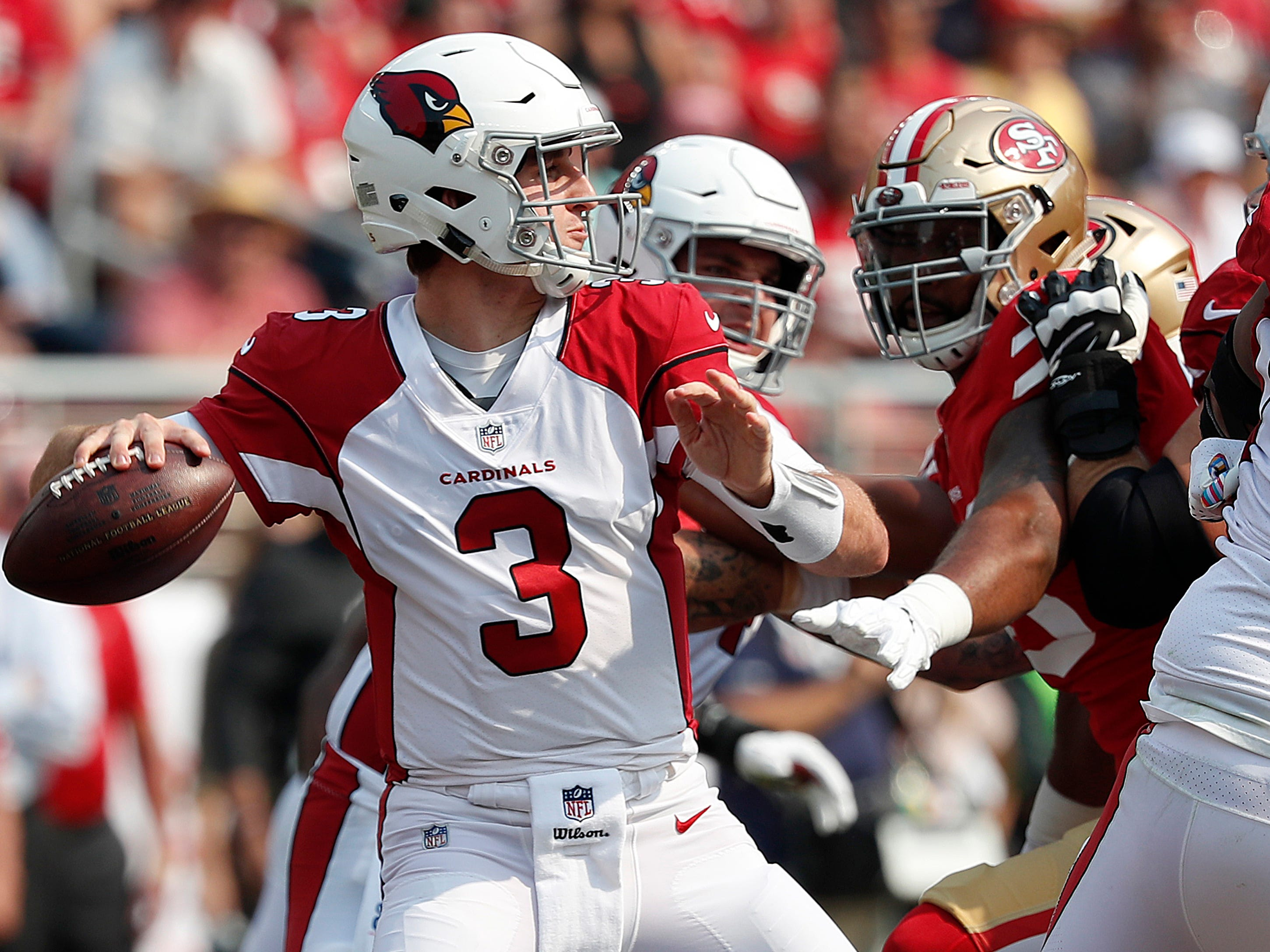 Arizona Cardinals quarterback Josh Rosen (3) looks to pass against the San Francisco 49ers during the first half of an NFL football game in Santa Clara, Calif., Sunday, Oct. 7, 2018.