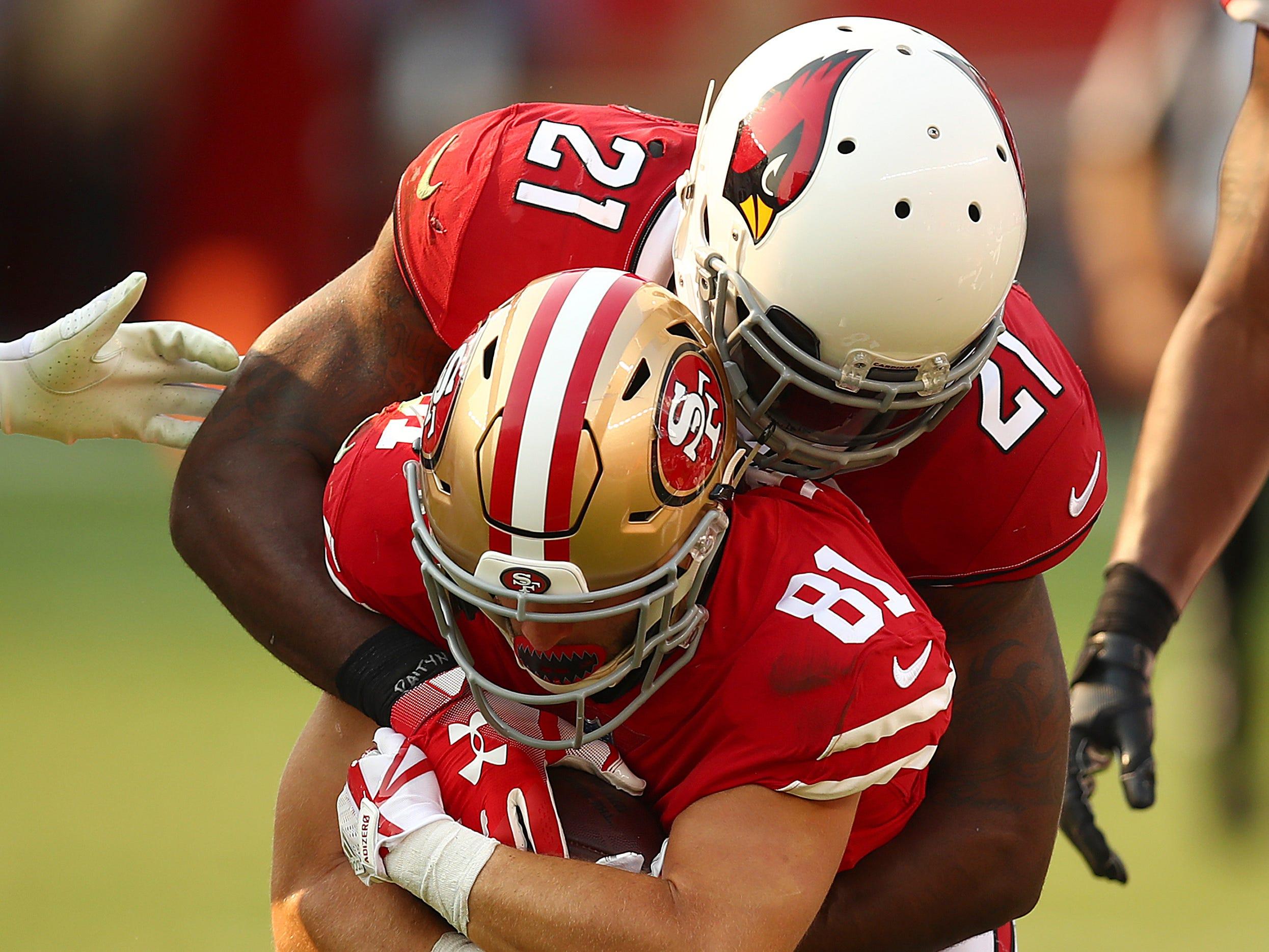 Arizona Cardinals cornerback Patrick Peterson (21) tackles San Francisco 49ers wide receiver Trent Taylor (81) during the second half of an NFL football game in Santa Clara, Calif., Sunday, Oct. 7, 2018.