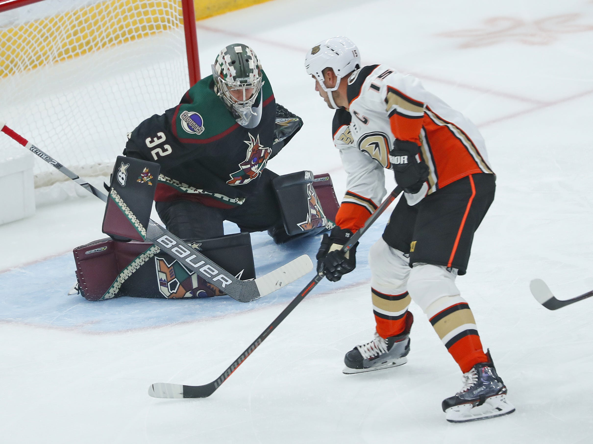 Coyotes Antii Raanta (32) makes a save on a shot from Ducks Ryan Getzlaf (15) during the first period at Gila River Arena in Glendale, Ariz. on October 6, 2018.