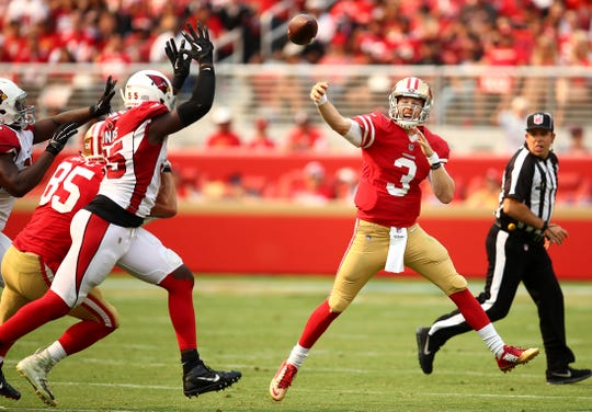 San Francisco 49ers quarterback C.J. Beathard (3) passes as Arizona Cardinals outside linebacker Chandler Jones (55) applies pressure during the first half of an NFL football game in Santa Clara, Calif., Sunday, Oct. 7, 2018.