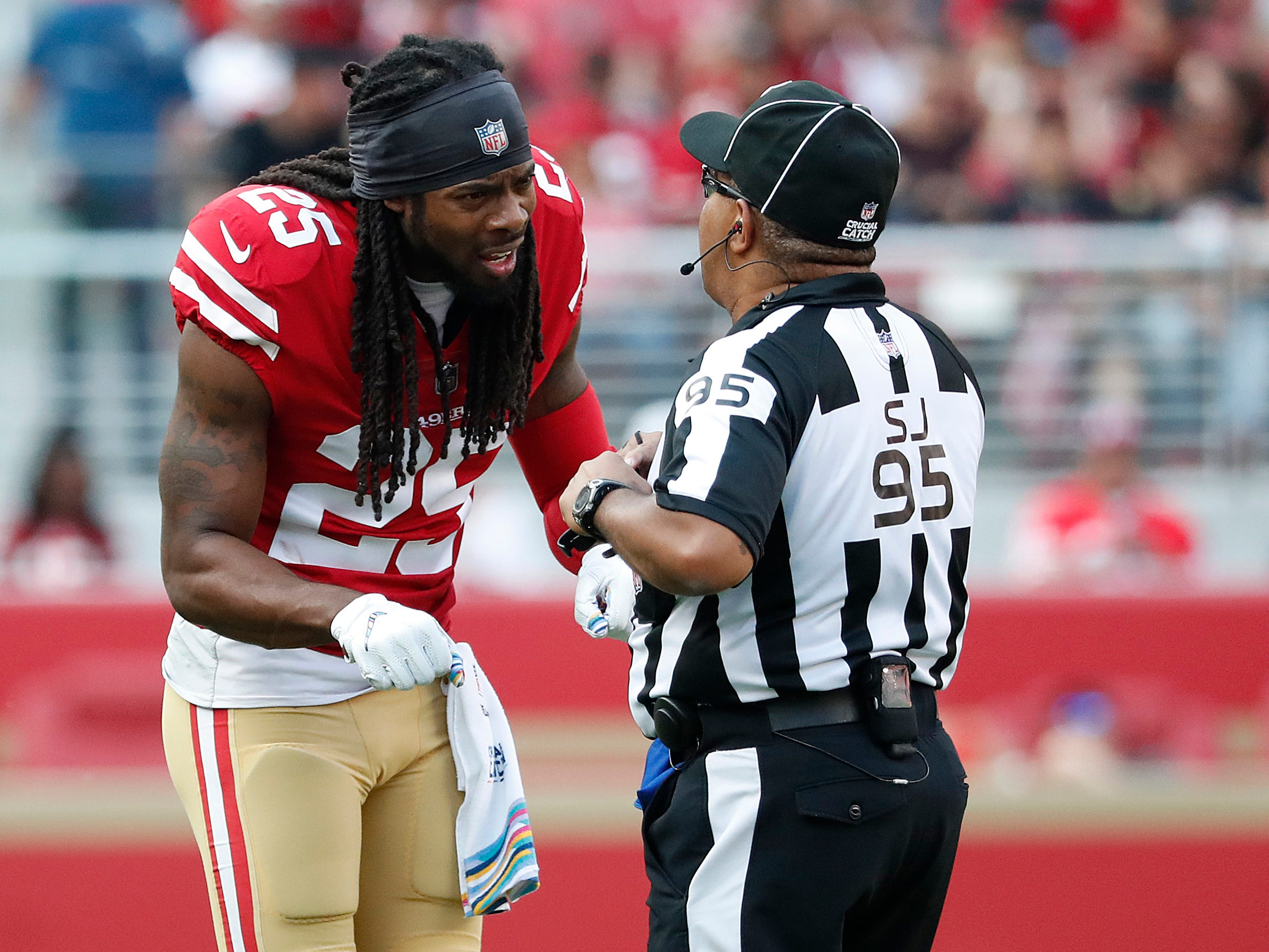 San Francisco 49ers defensive back Richard Sherman (25) talks with field judge James Coleman during the second half of an NFL football game between the 49ers and the Arizona Cardinals in Santa Clara, Calif., Sunday, Oct. 7, 2018.