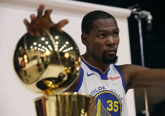 Golden State Warriors' Kevin Durant poses for photos during media day at the NBA basketball team's practice facility in Oakland, Calif., Monday, Sept. 24, 2018. (AP Photo/Jeff Chiu)