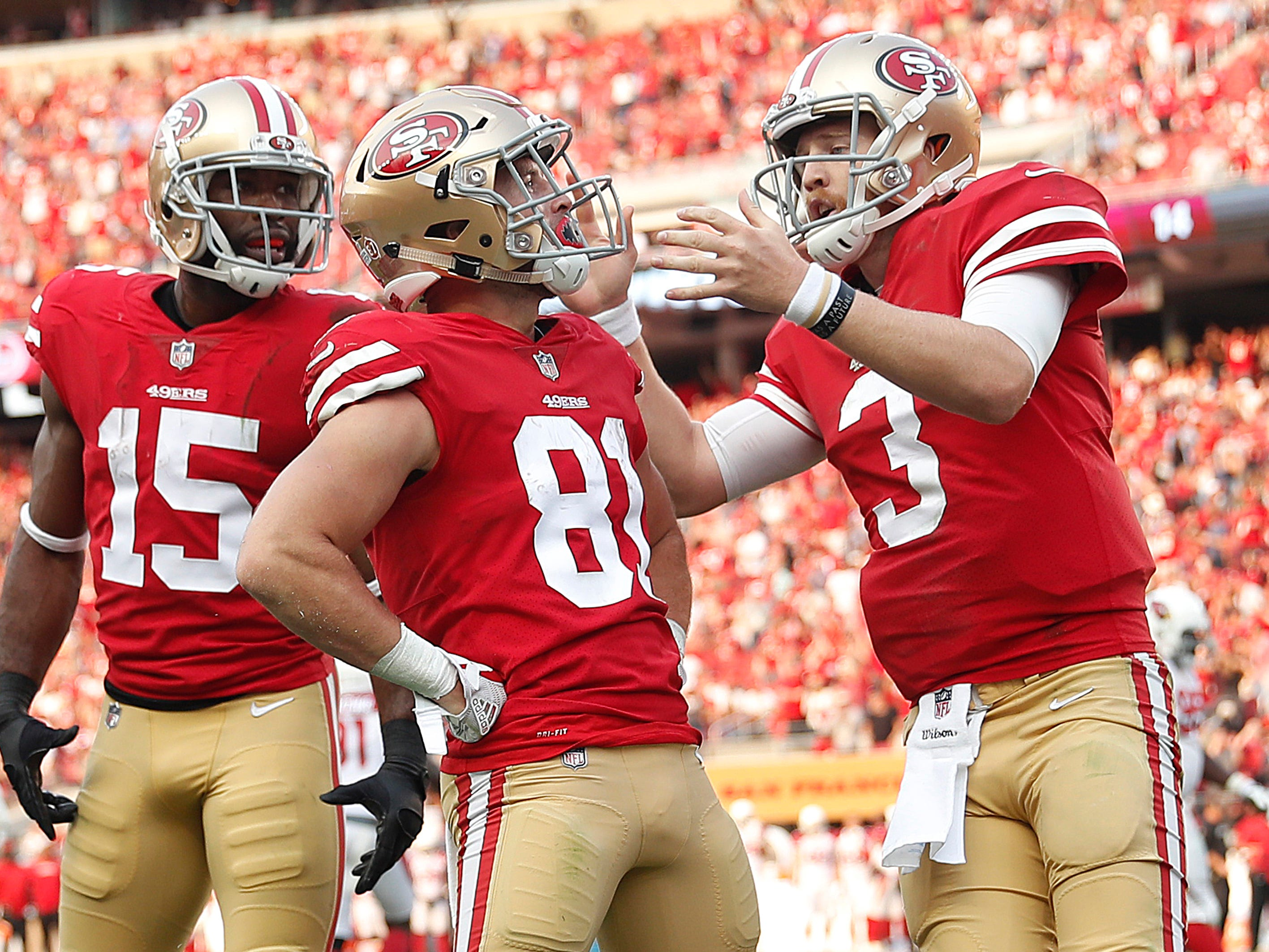 San Francisco 49ers wide receiver Trent Taylor (81) is congratulated by wide receiver Pierre Garcon (15) and quarterback C.J. Beathard (3) after scoring against the Arizona Cardinals during the second half of an NFL football game in Santa Clara, Calif., Sunday, Oct. 7, 2018.
