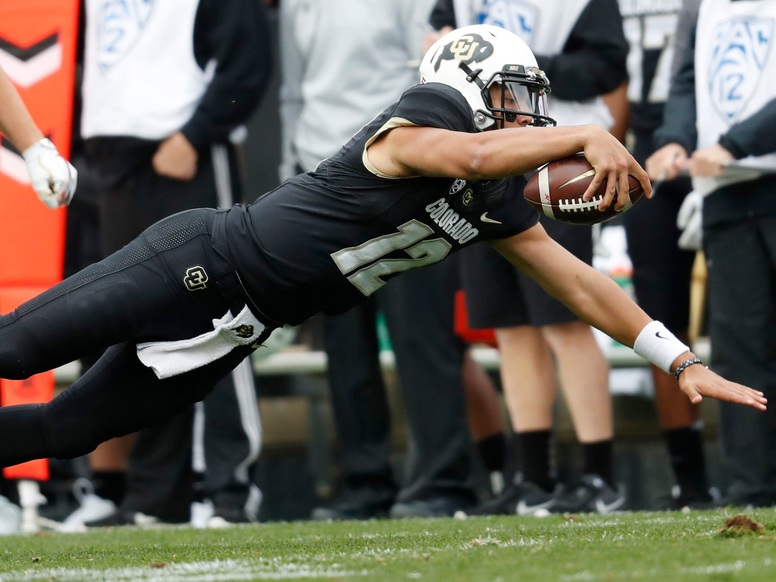 Colorado quarterback Steven Montez dives for yardage after getting tripped up while running against Arizona State in the second half of an NCAA college football game Saturday, Oct. 6, 2018, in Boulder, Colo. Colorado won 28-21. (AP Photo/David Zalubowski)