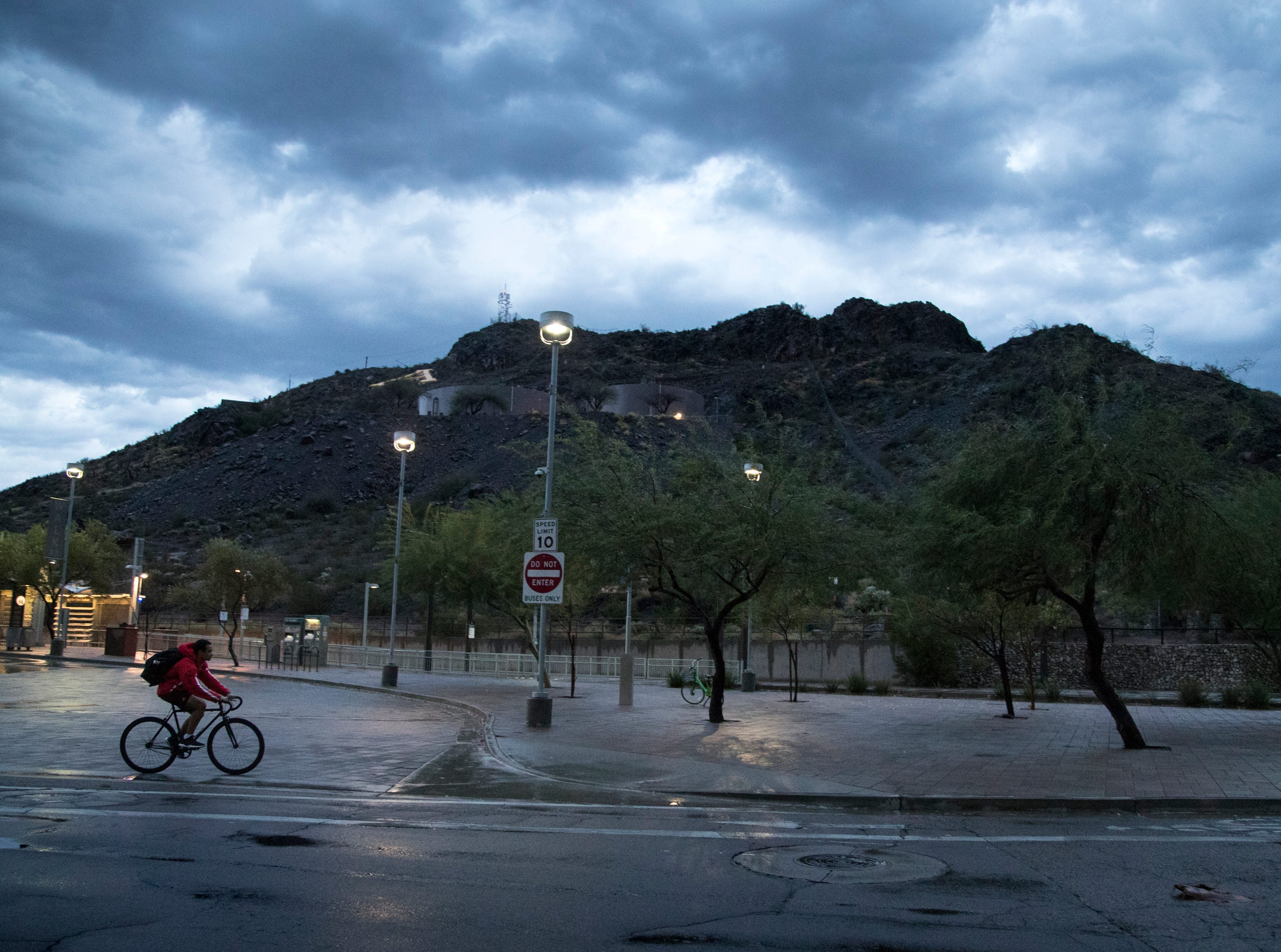 A biker rides along Fifth Street, Oct. 7, 2018, Tempe.