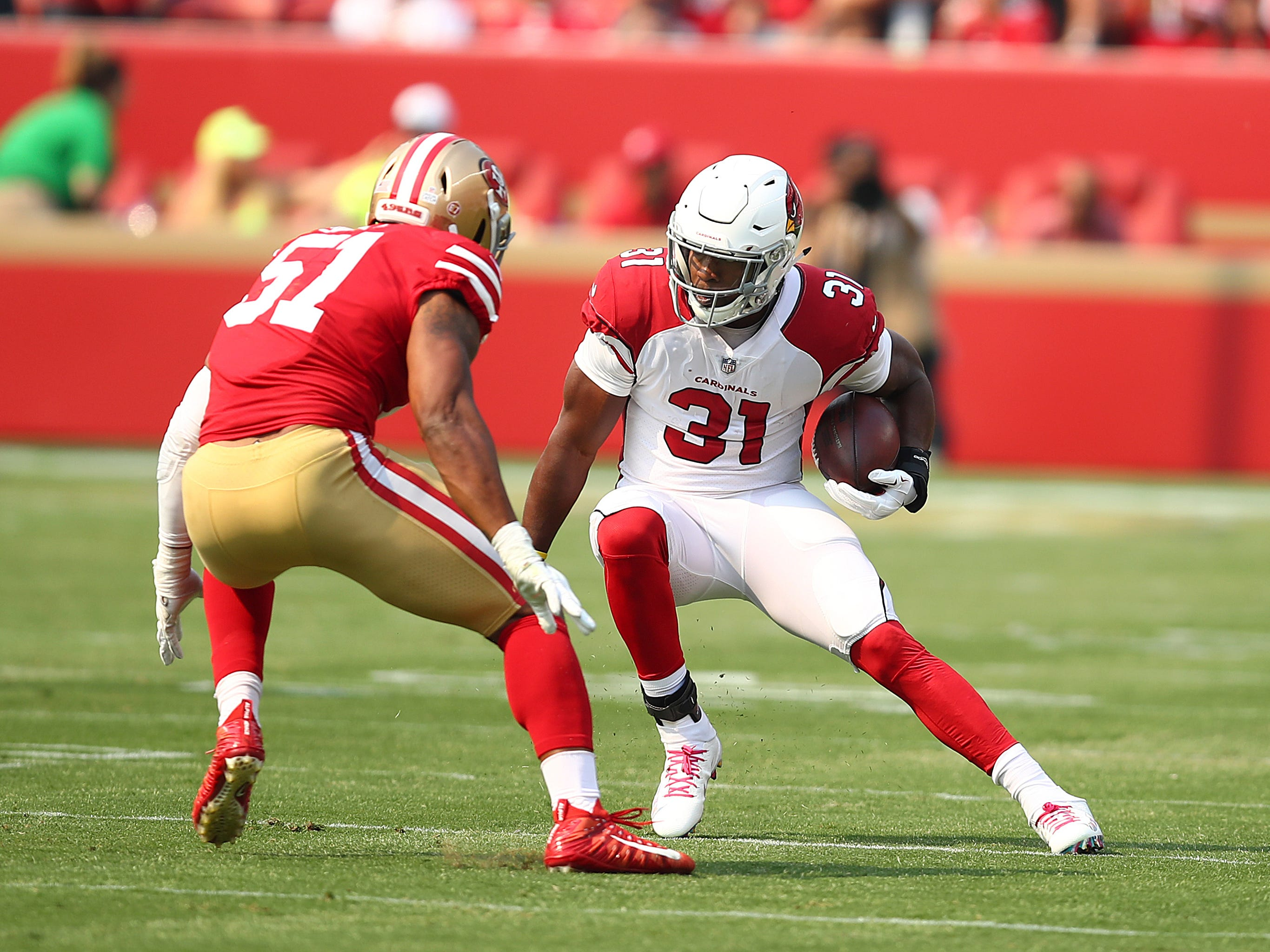 Arizona Cardinals running back David Johnson (31) runs against San Francisco 49ers linebacker Malcolm Smith (51) during the first half of an NFL football game in Santa Clara, Calif., Sunday, Oct. 7, 2018.