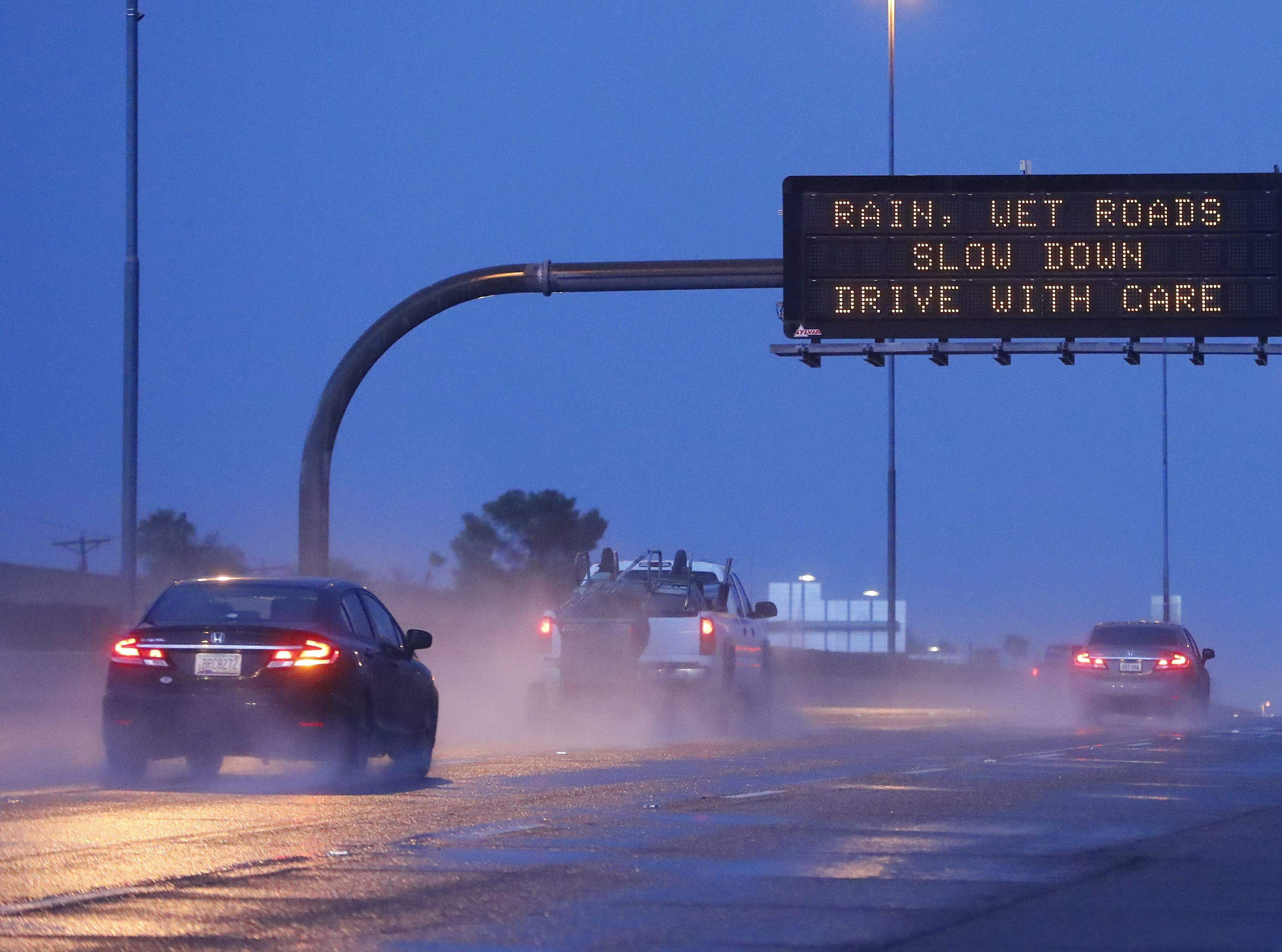 Drivers make their way eastbound on U.S. 60 highway as rain hits the Valley in Tempe, Oct. 7, 2018.