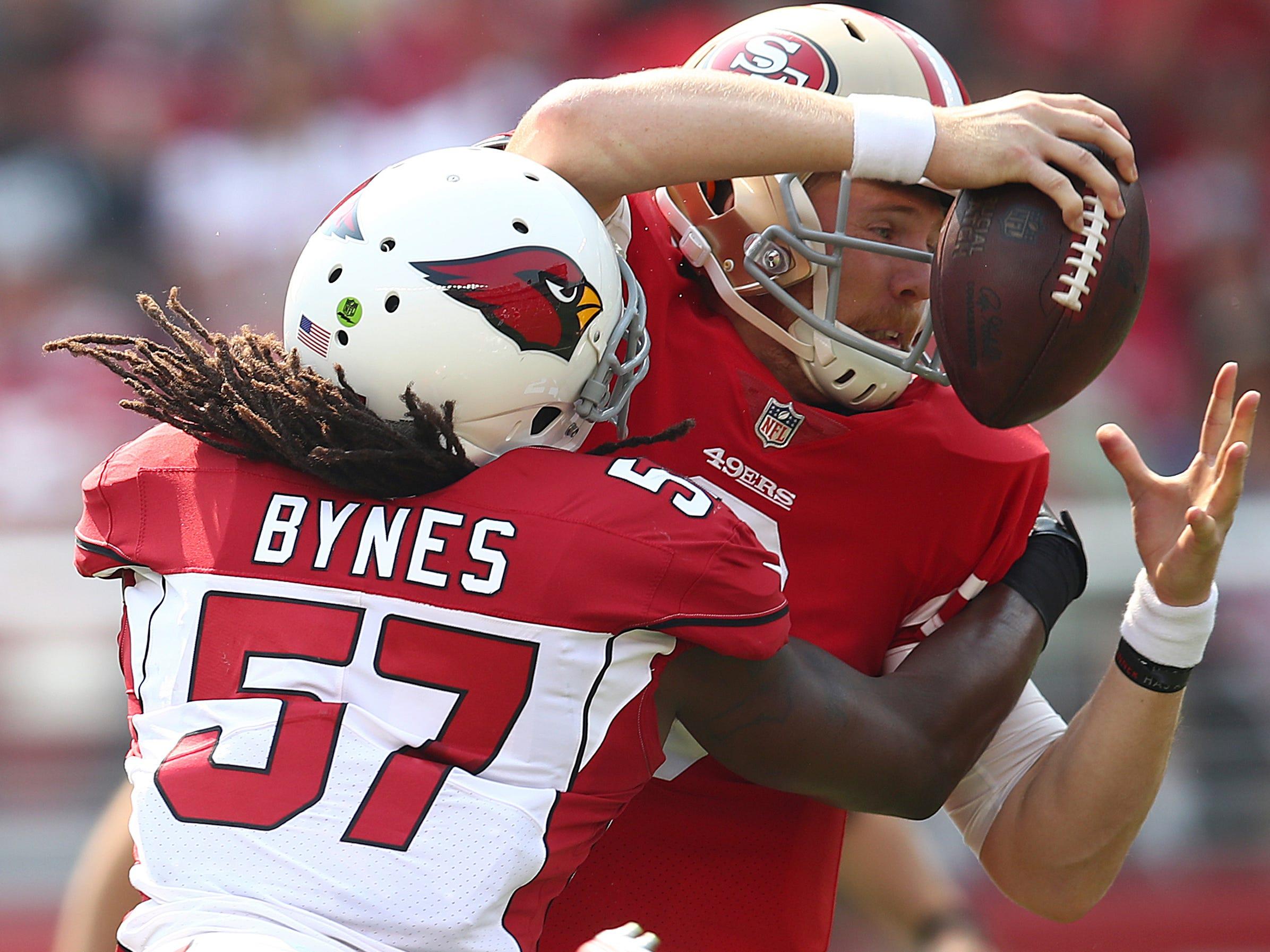 Arizona Cardinals linebacker Josh Bynes (57) sacks San Francisco 49ers quarterback C.J. Beathard during the first half of an NFL football game in Santa Clara, Calif., Sunday, Oct. 7, 2018.