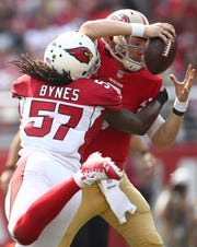 Arizona Cardinals linebacker Josh Bynes (57) sacks San Francisco 49ers quarterback C.J. Beathard during the first half of an NFL football game in Santa Clara, Calif., Sunday, Oct. 7, 2018.