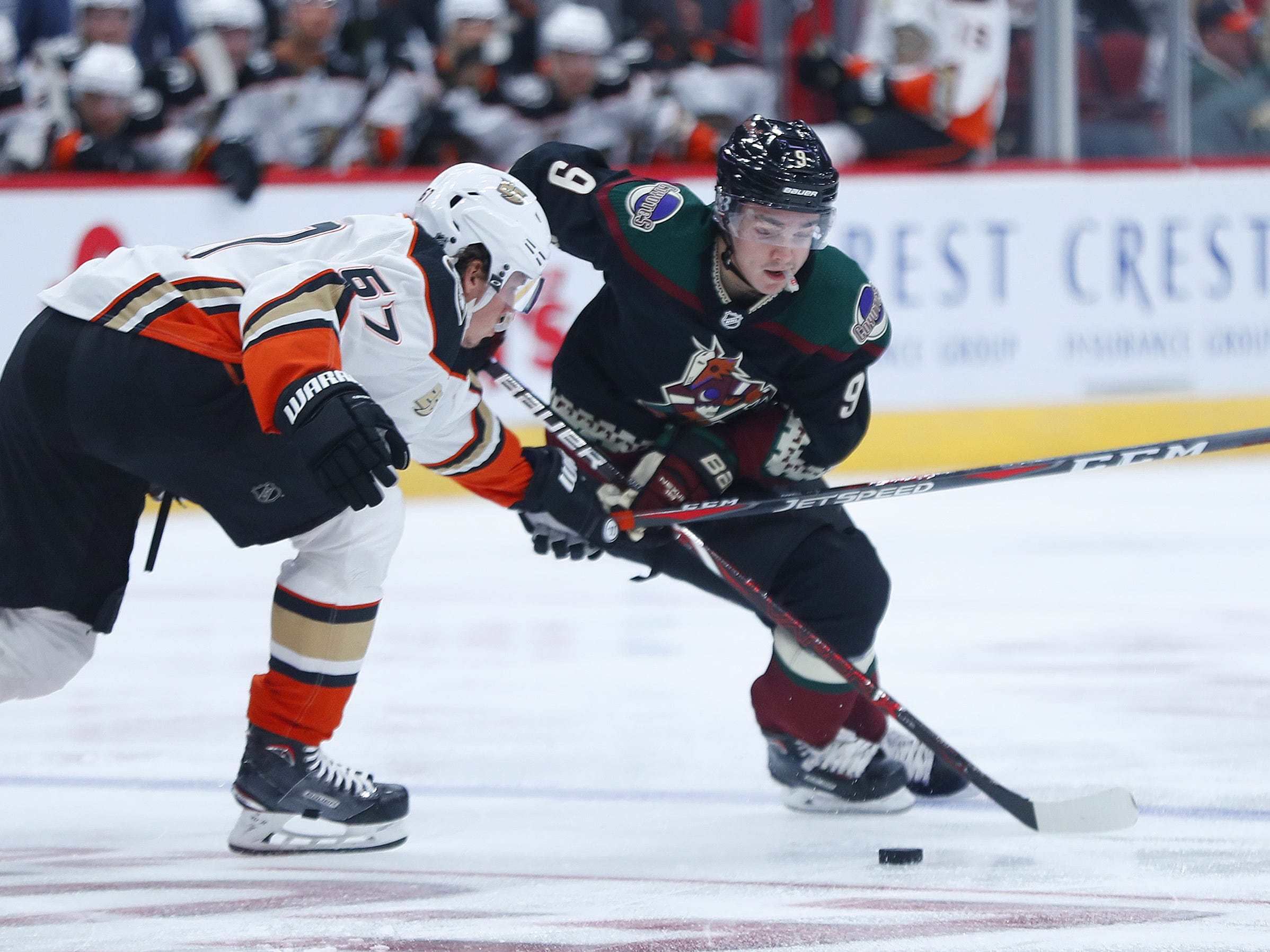 Coyotes Clayton Keller (9) skates with the puck against Ducks Rickard Rakell (67) during the second period at Gila River Arena in Glendale, Ariz. on October 6, 2018.
