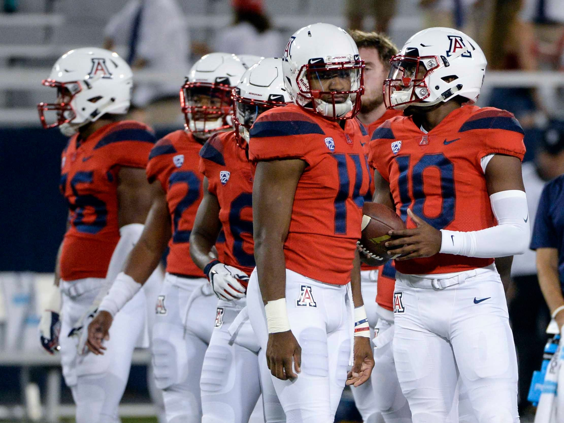 Oct 6, 2018; Tucson, AZ, USA; Arizona Wildcats quarterback Khalil Tate (14) and quarterback Jamarye Joiner (10) (right) warm up before playing the California Golden Bears at Arizona Stadium. Mandatory Credit: Casey Sapio-USA TODAY Sports