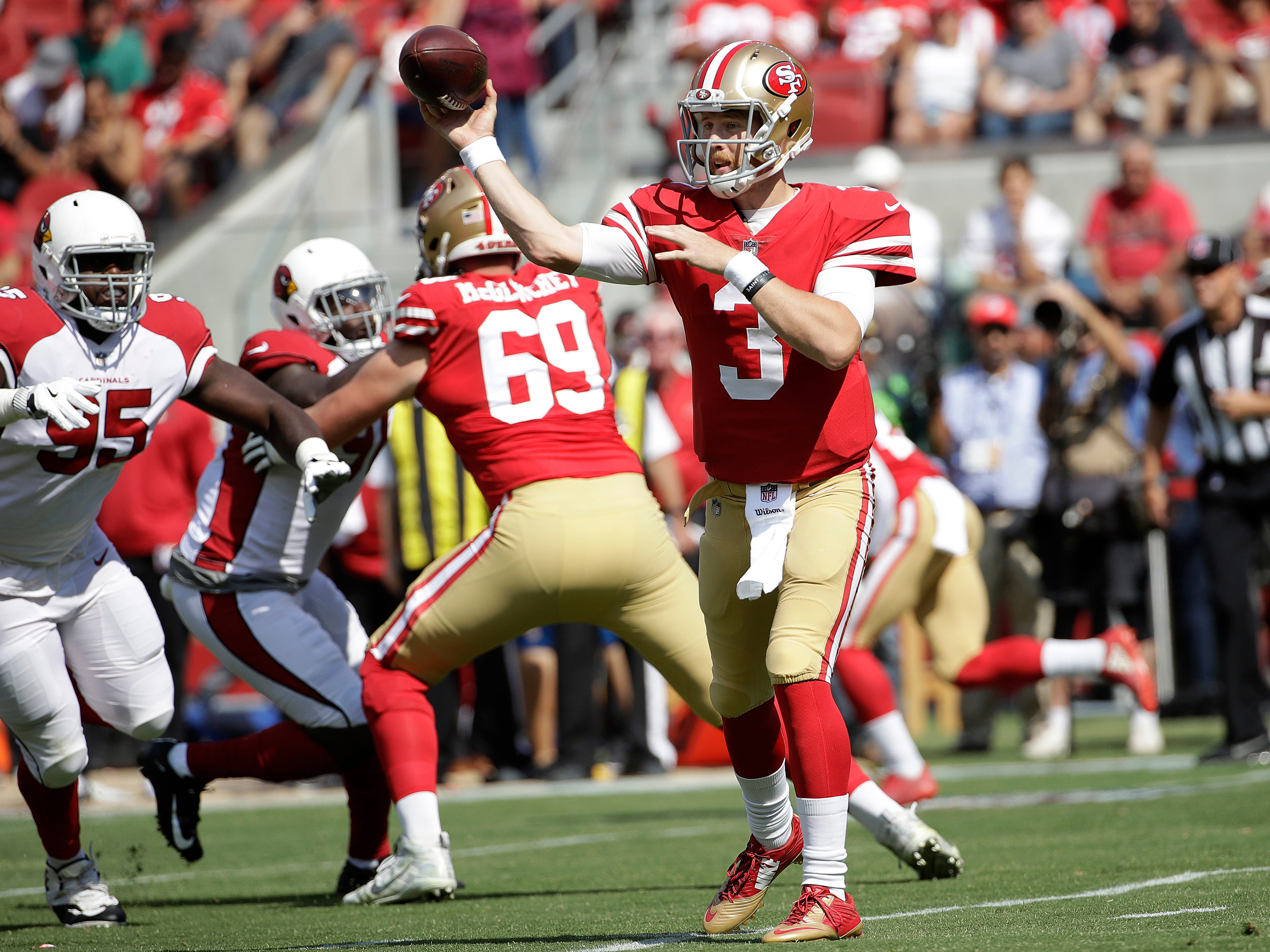 San Francisco 49ers quarterback C.J. Beathard (3) passes against the Arizona Cardinals during the first half of an NFL football game in Santa Clara, Calif., Sunday, Oct. 7, 2018.