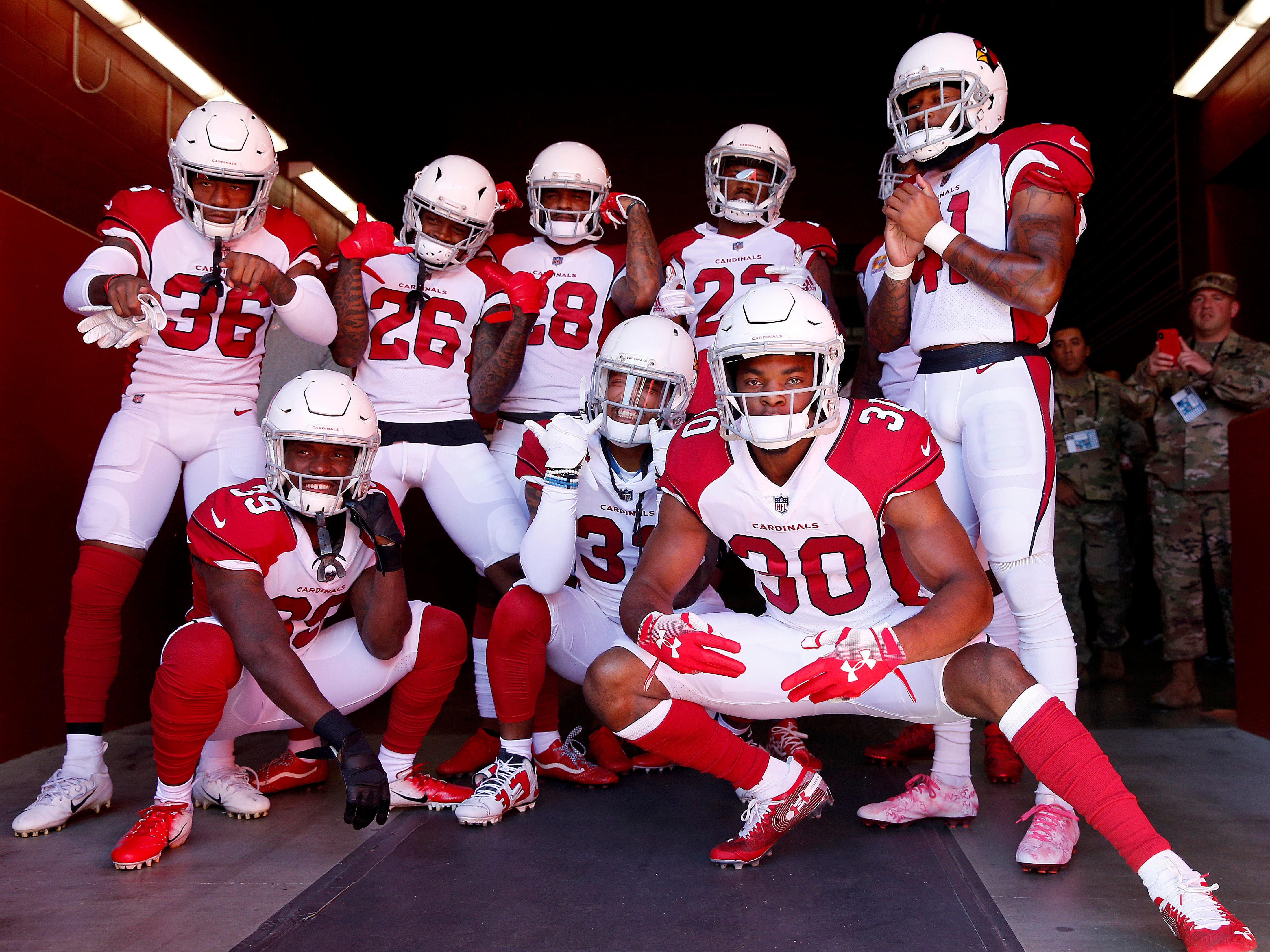 Oct 7, 2018; Santa Clara, CA, USA; Arizona Cardinals defensive back Rudy Ford (30) poses for a photo with teammates before the start of the game against the San Francisco 49ers at Levi's Stadium.
