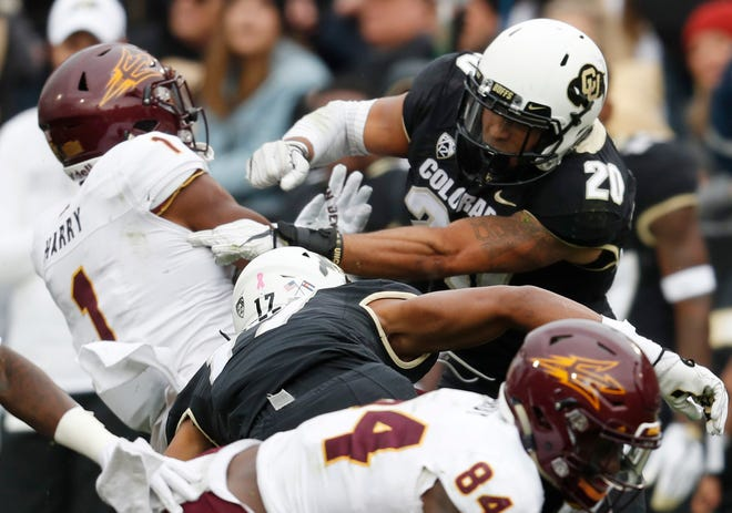 Colorado linebacker Drew Lewis, right, hits Arizona State punt returner N'Keal Harry in the second half of an NCAA college football game Saturday, Oct. 6, 2018, in Boulder, Colo. Colorado won 28-21.