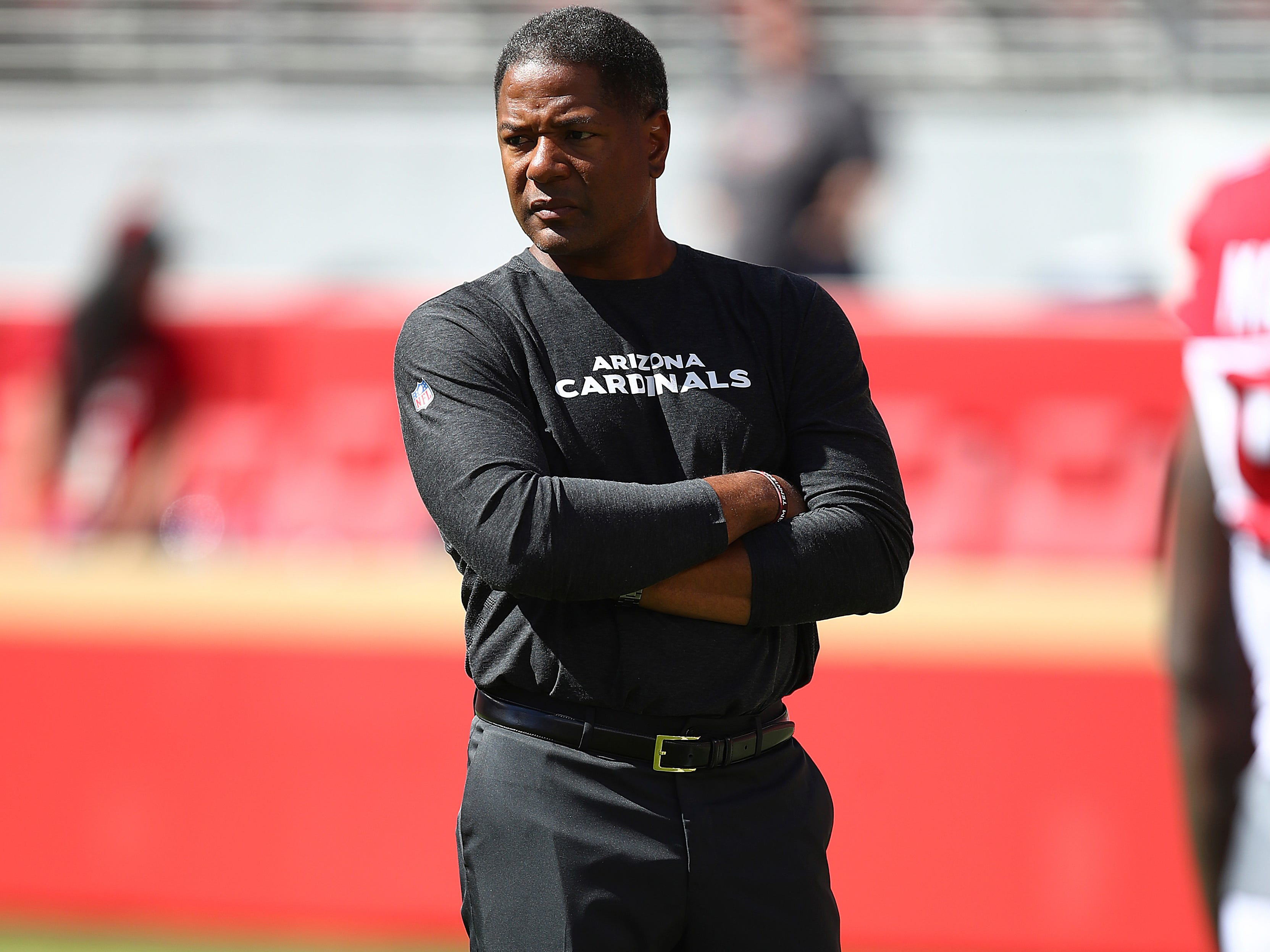 Arizona Cardinals head coach Steve Wilks watches as players warm up before an NFL football game against the San Francisco 49ers in Santa Clara, Calif., Sunday, Oct. 7, 2018.