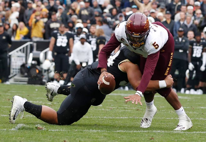 Arizona State quarterback Manny Wilkins, right, is sacked by Colorado defensive lineman Mustafa Johnson in the second half of an NCAA college football game Saturday, Oct. 6, 2018, in Boulder, Colo. Colorado won 28-21.