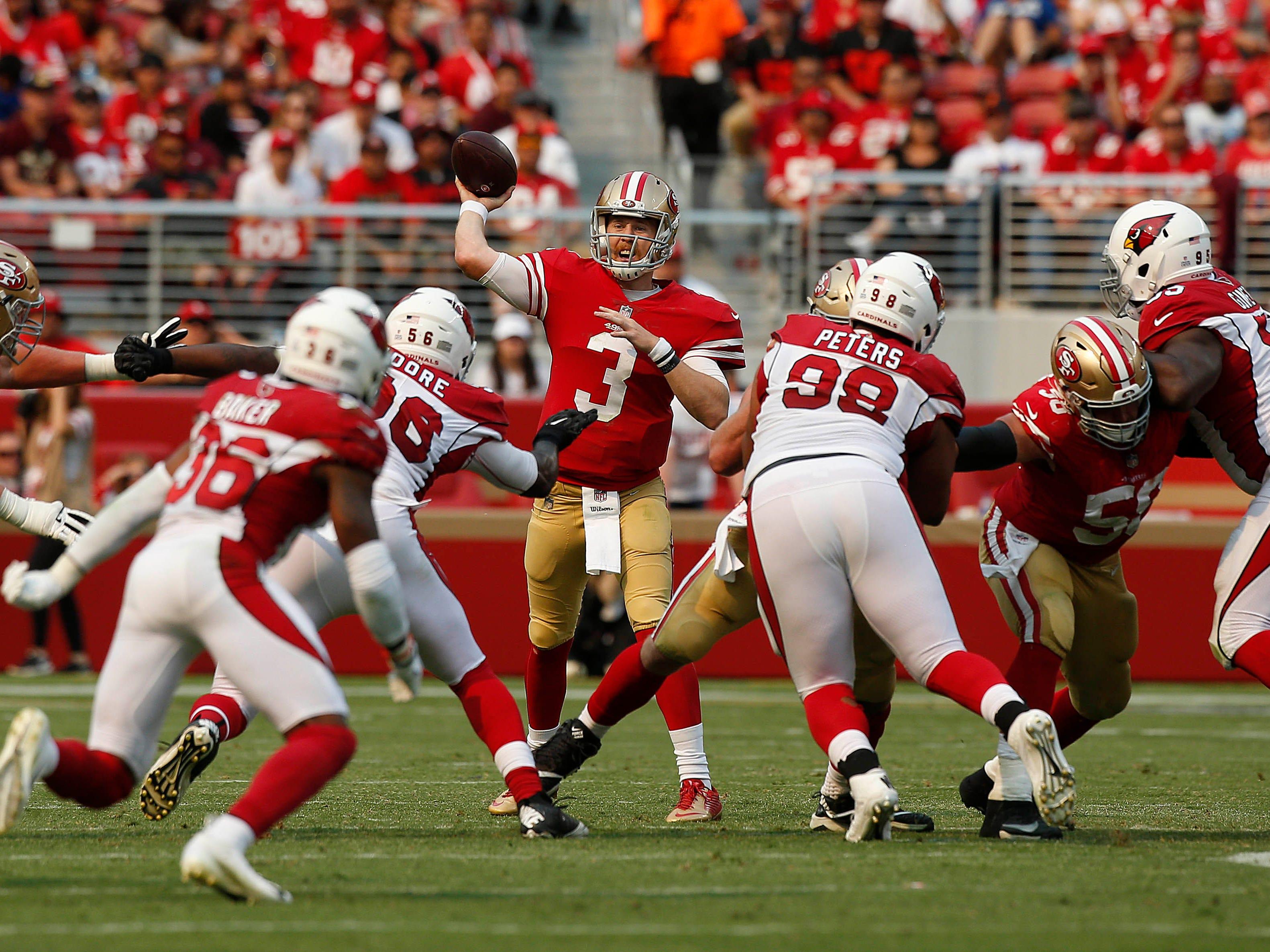 Oct 7, 2018; Santa Clara, CA, USA; San Francisco 49ers quarterback C.J. Beathard (3) throws a pass against the Arizona Cardinals in the second quarter at Levi's Stadium.