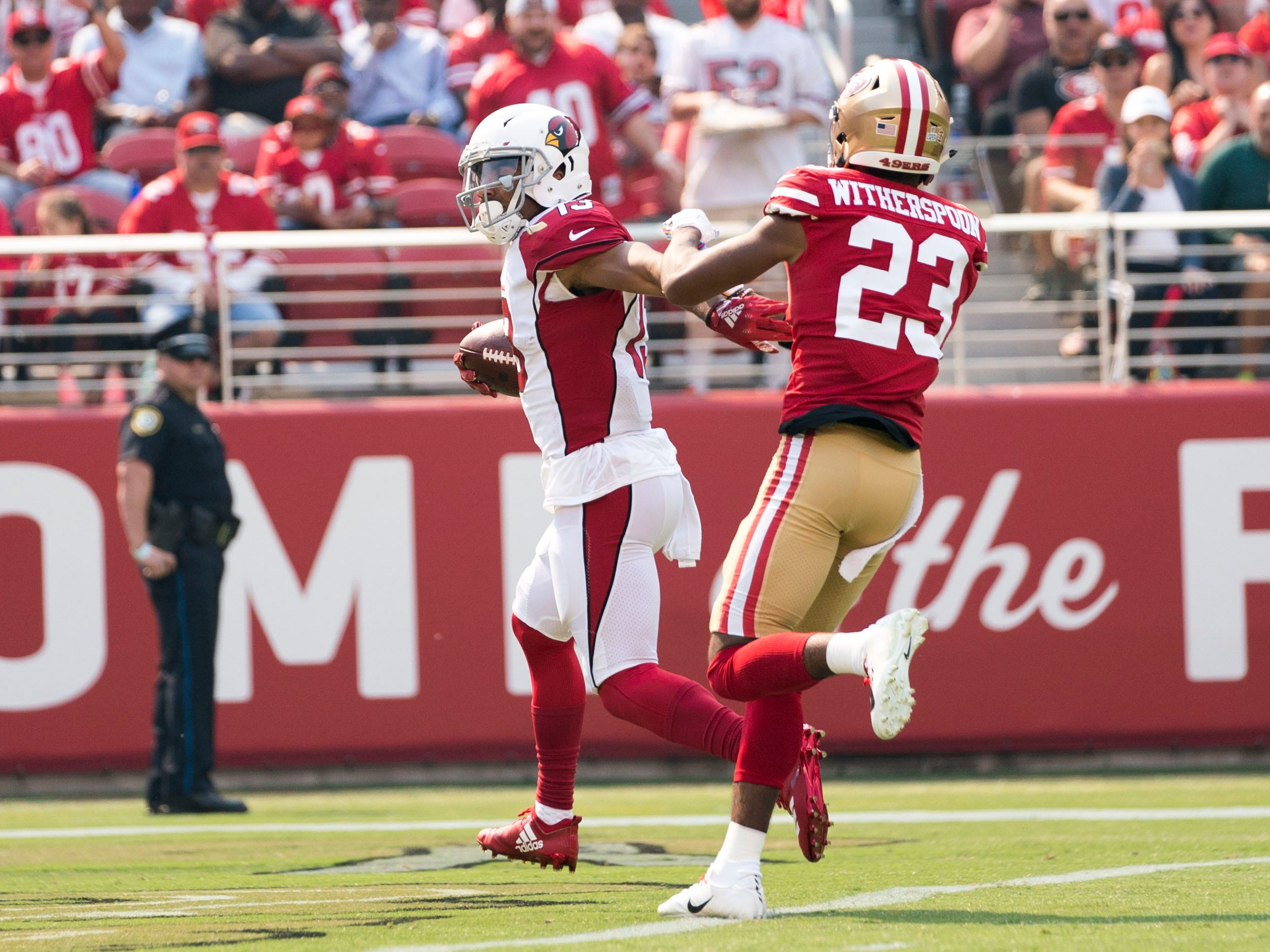 October 7, 2018; Santa Clara, CA, USA; Arizona Cardinals wide receiver Christian Kirk (13) scores a touchdown against San Francisco 49ers cornerback Ahkello Witherspoon (23) during the first quarter at Levi's Stadium.