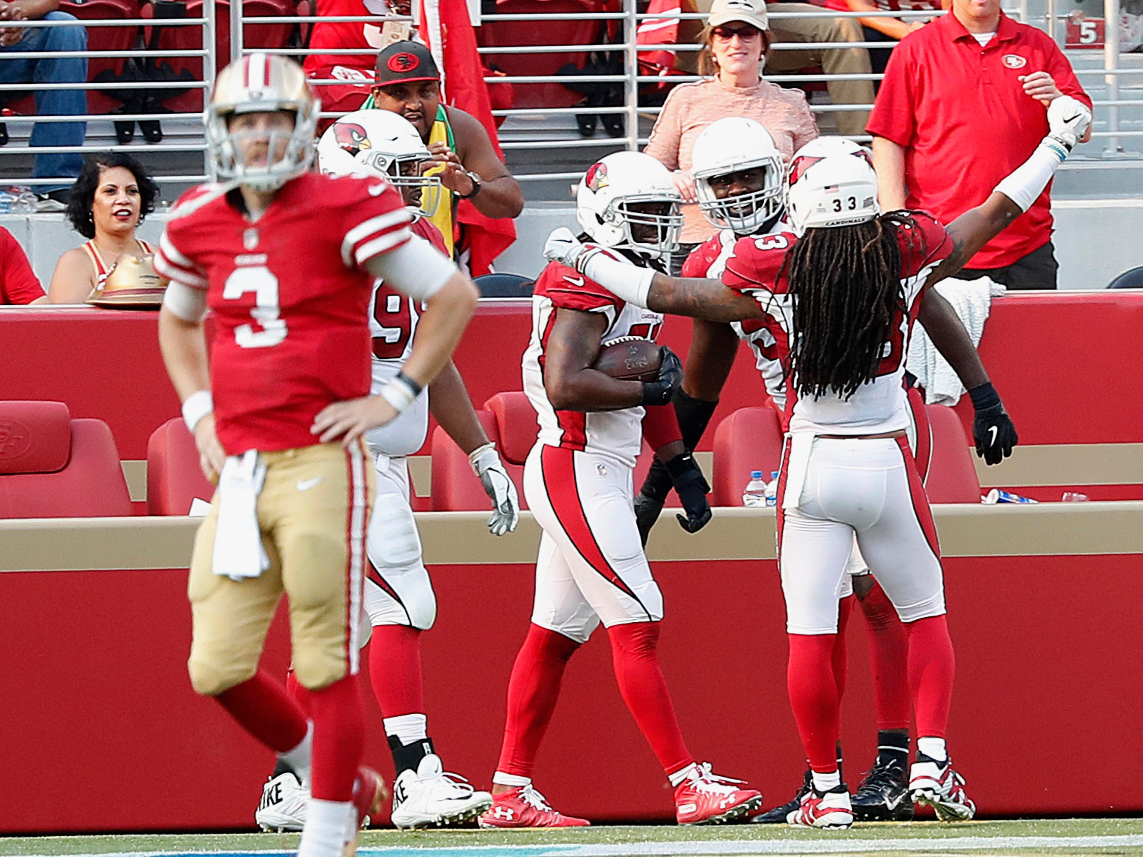 Arizona Cardinals linebacker Josh Bynes, bottom center, celebrates with teammates after returning a fumble by San Francisco 49ers quarterback C.J. Beathard (3) for a touchdown during the second half of an NFL football game in Santa Clara, Calif., Sunday, Oct. 7, 2018.