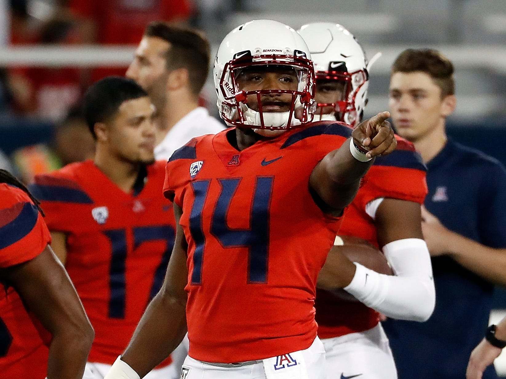 Arizona quarterback Khalil Tate (14) and teammates warm up for the team's NCAA college football game against California on Saturday, Oct. 6, 2018, in Tucson, Ariz. (AP Photo/Chris Coduto)