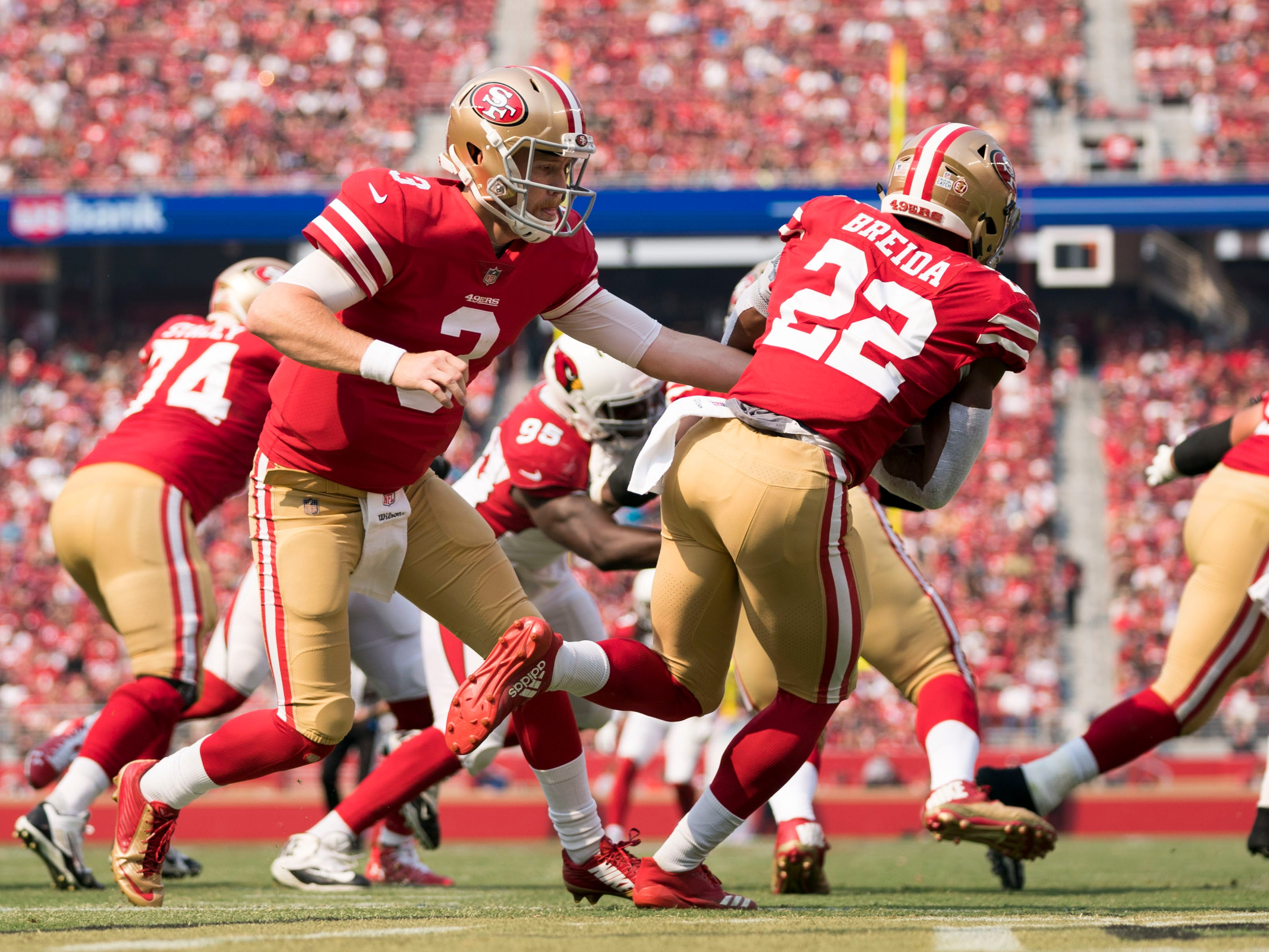 October 7, 2018; Santa Clara, CA, USA; San Francisco 49ers quarterback C.J. Beathard (3) hands the football to running back Matt Breida (22) against the Arizona Cardinals during the first quarter at Levi's Stadium. Mandatory Credit: Kyle Terada-USA TODAY Sports