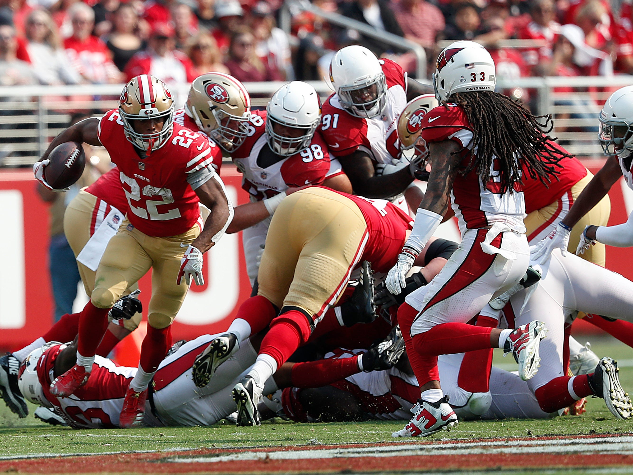 San Francisco 49ers running back Matt Breida (22) runs against the Arizona Cardinals during the first half of an NFL football game in Santa Clara, Calif., Sunday, Oct. 7, 2018.