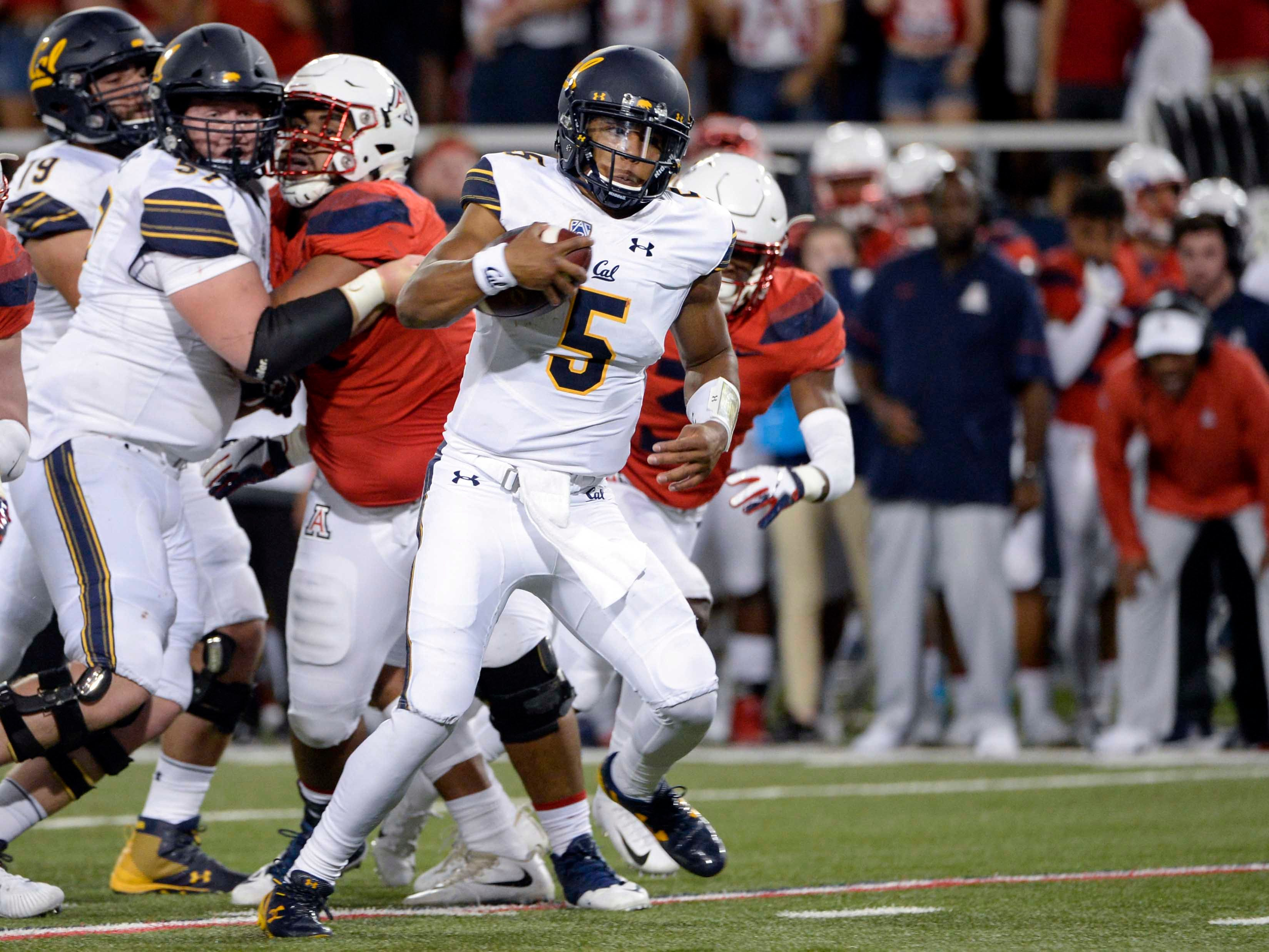 Oct 6, 2018; Tucson, AZ, USA; California Golden Bears quarterback Brandon McIlwain (5) runs the ball for a touchdown against the Arizona Wildcats during the first half at Arizona Stadium. Mandatory Credit: Casey Sapio-USA TODAY Sports