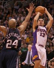 Steve Nash makes a fall-away jumper over Nets forward Richard Jefferson in 2005.