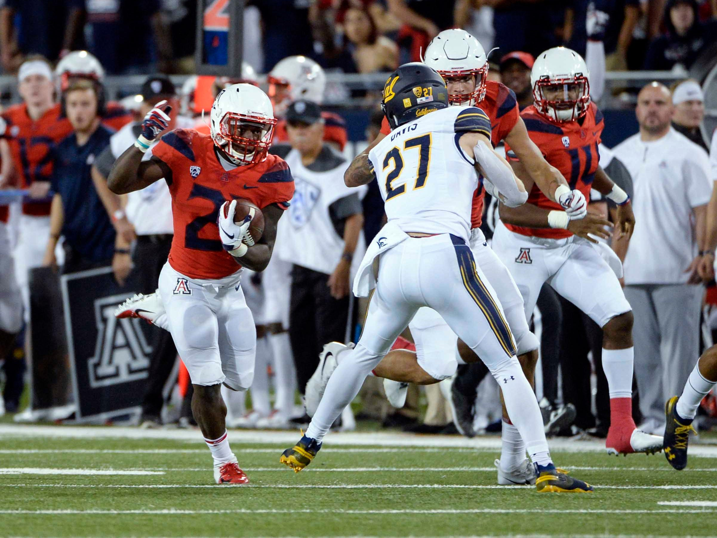 Oct 6, 2018; Tucson, AZ, USA; Arizona Wildcats running back J.J. Taylor (21) runs the ball against the California Golden Bears during the first half at Arizona Stadium. Mandatory Credit: Casey Sapio-USA TODAY Sports