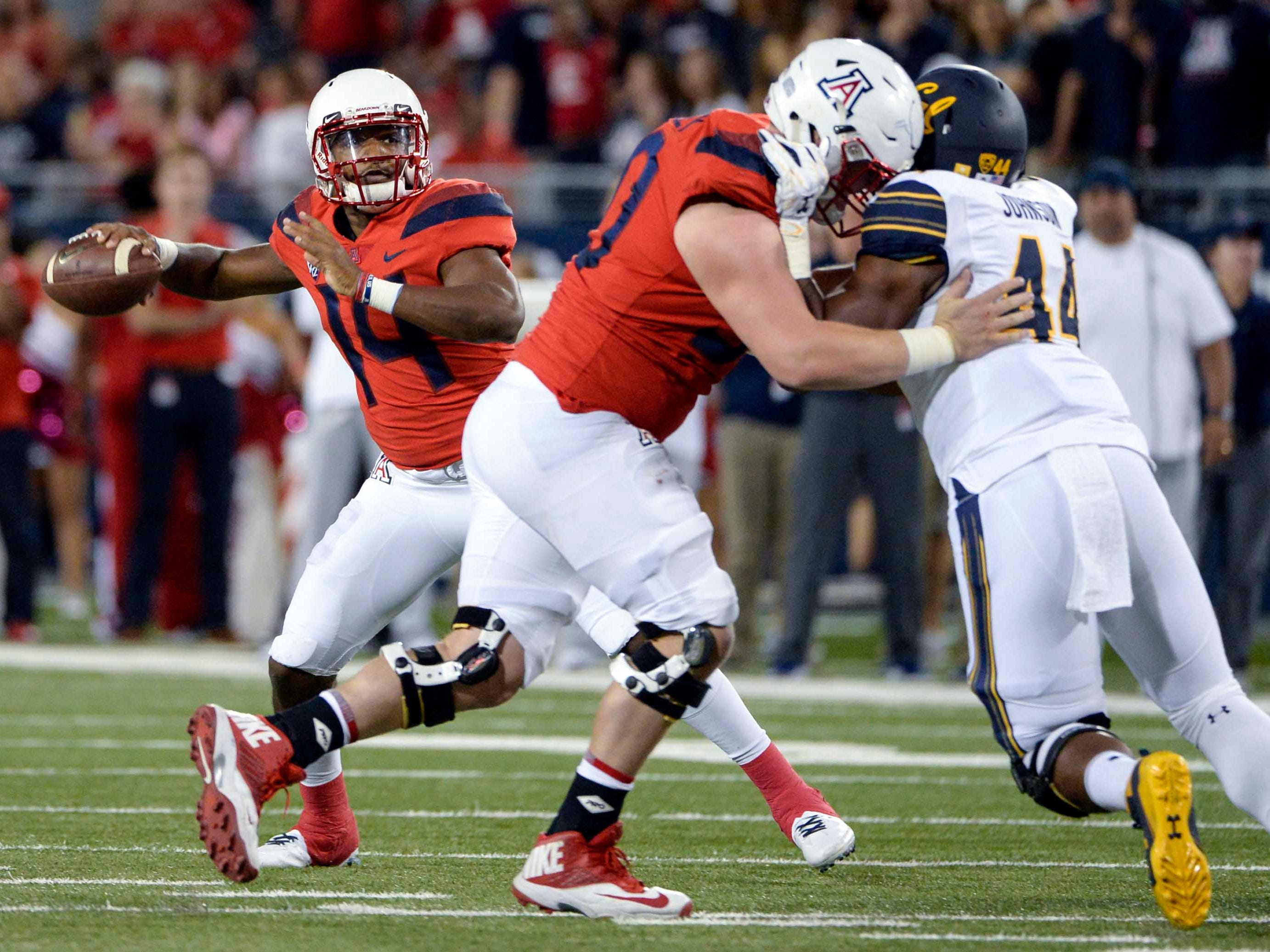 Oct 6, 2018; Tucson, AZ, USA; Arizona Wildcats quarterback Khalil Tate (14) passes the ball against the California Golden Bears during the first half at Arizona Stadium. Mandatory Credit: Casey Sapio-USA TODAY Sports