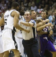 Officials separate Robert Horry and Steve Nash after Horry hip-checked Nash into the scorer's table in the 2007 playoffs.
