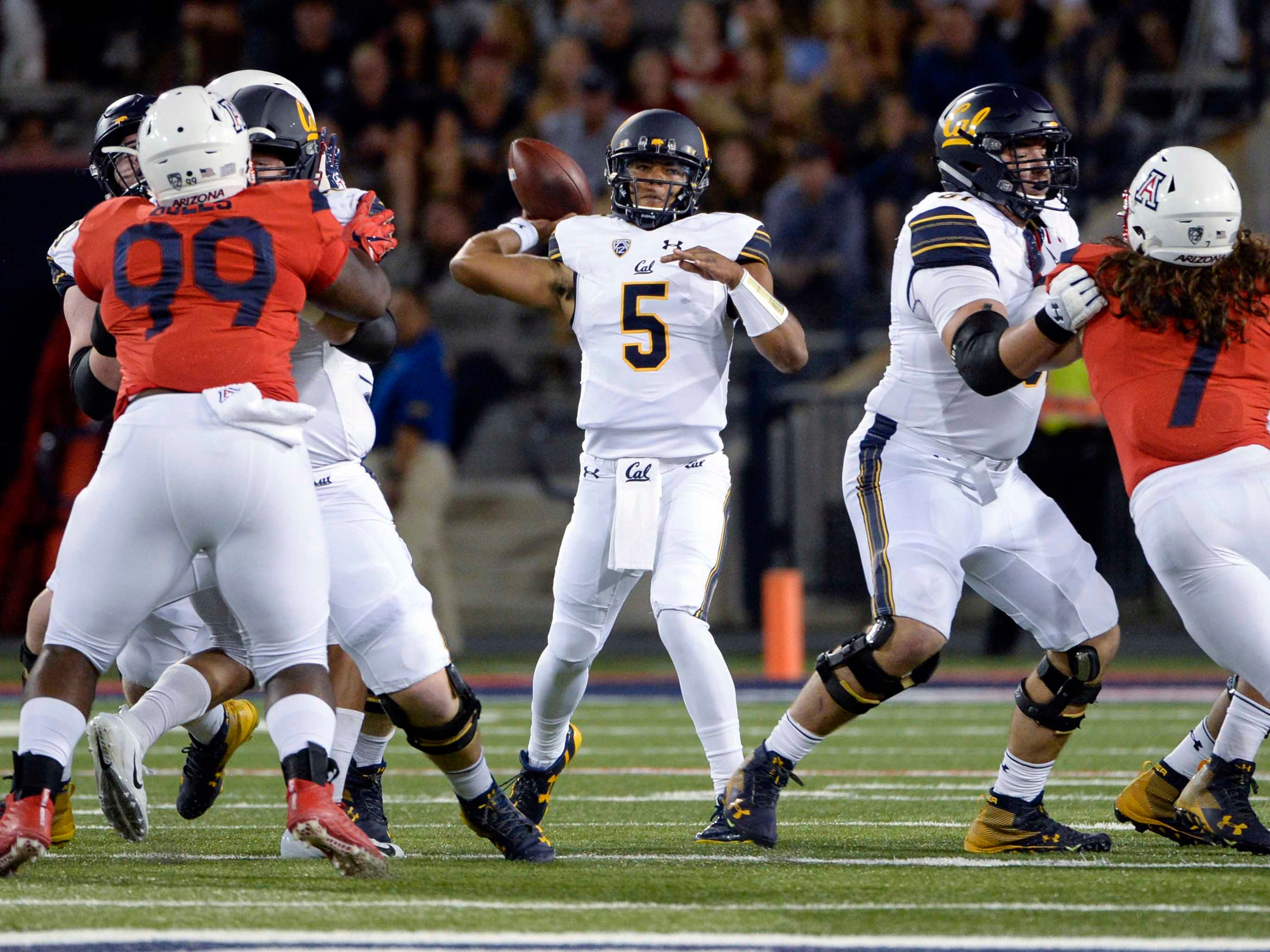 Oct 6, 2018; Tucson, AZ, USA; California Golden Bears quarterback Brandon McIlwain (5) passes the ball against the Arizona Wildcats during the first half at Arizona Stadium. Mandatory Credit: Casey Sapio-USA TODAY Sports