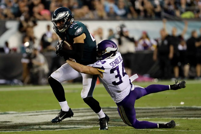 Philadelphia Eagles' Zach Ertz, left, is tackled by Minnesota Vikings' Andrew Sendejo during the second half of an NFL football game Sunday, Oct. 7, 2018, in Philadelphia. (AP Photo/Michael Perez)