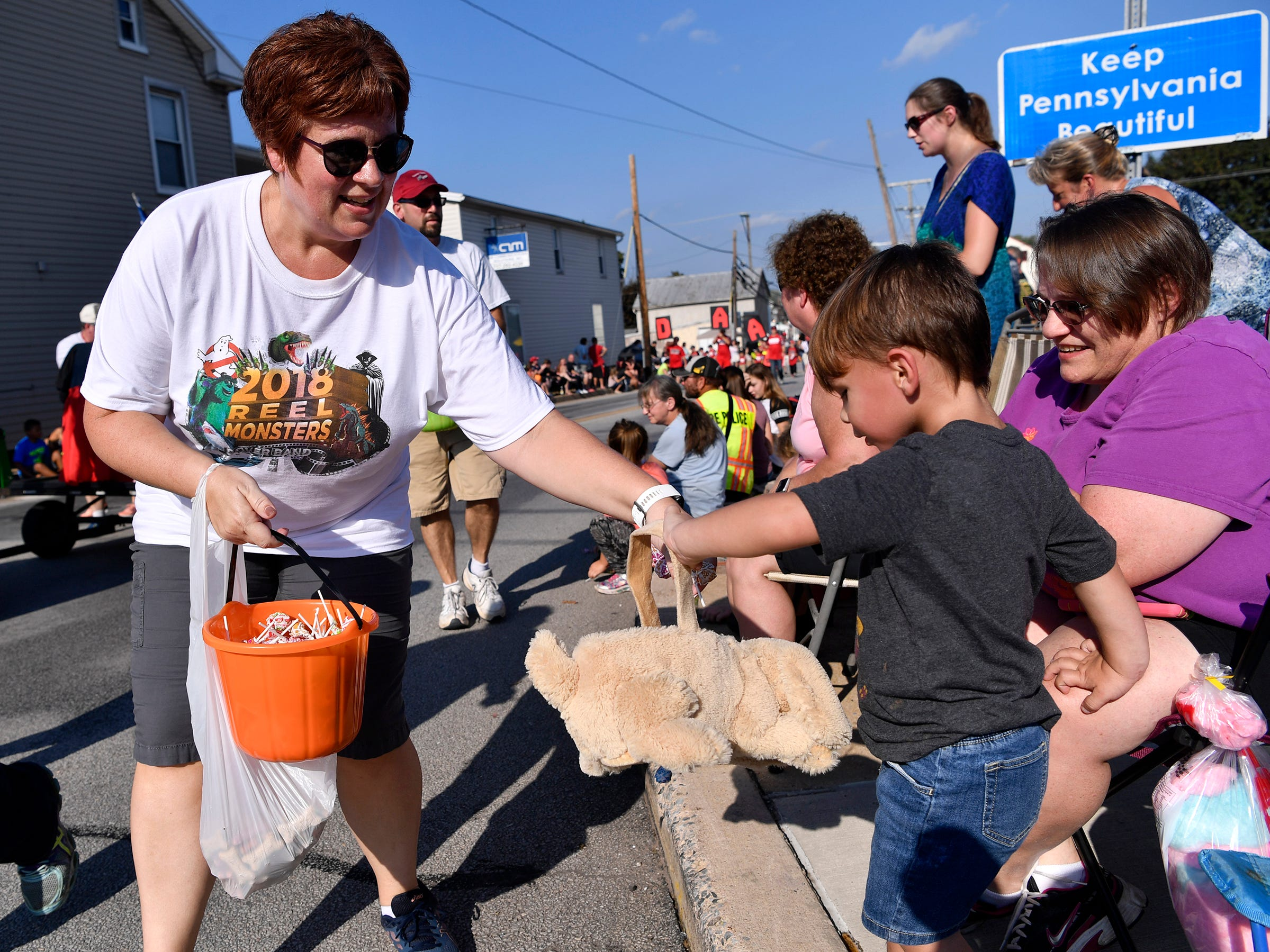 Noah Waugh, 3 of Dover, right, gets a handful of candy while attending the Dover Halloween Parade with his grandparents, Sunday Oct. 7, 2018. John A. Pavoncello photo