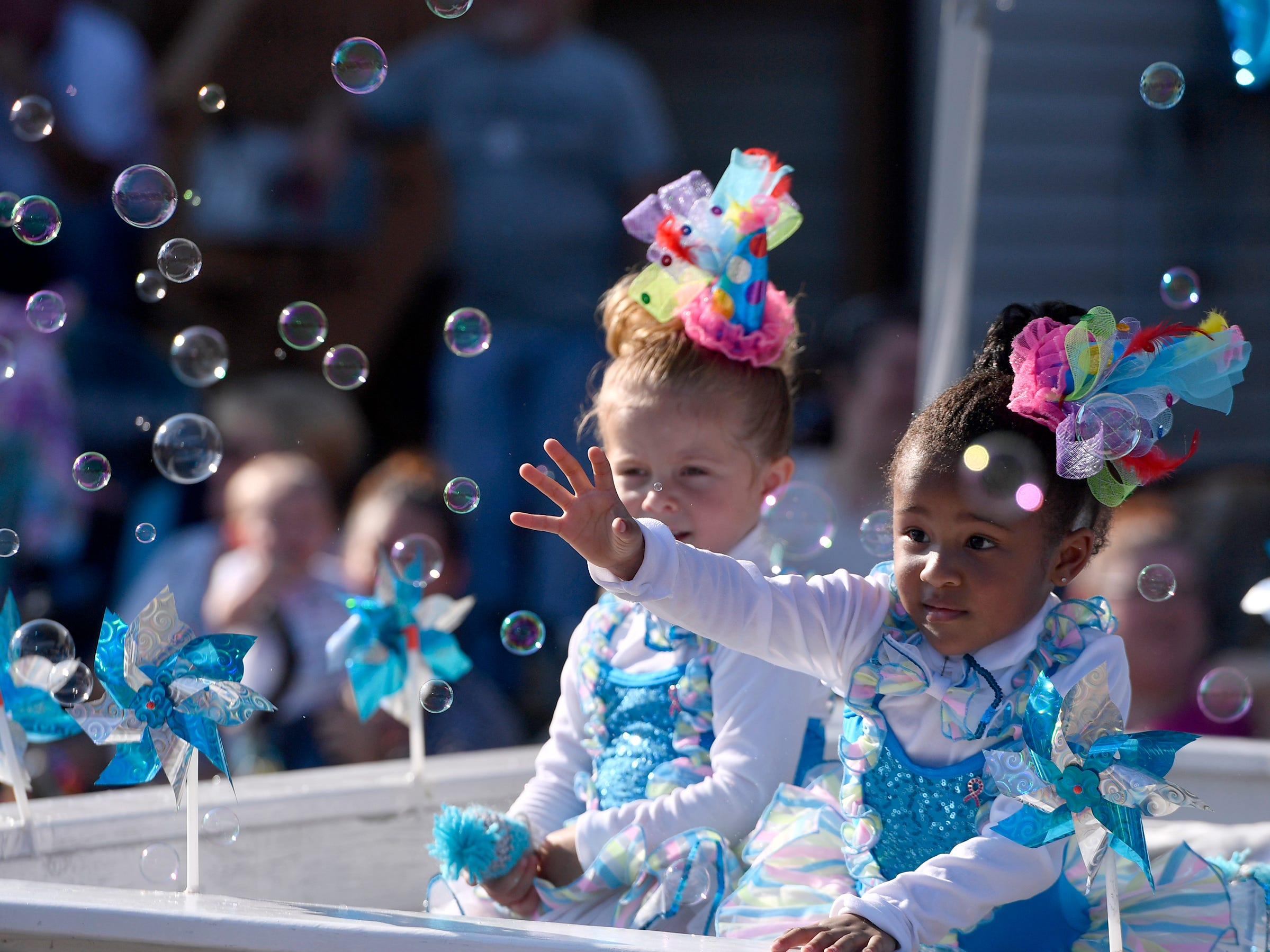 Tiny Tots with Kim's Firecrackers play with bubbles floating by during the Dover Halloween Parade, Sunday Oct. 7, 2018. John A. Pavoncello photo
