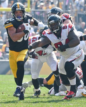 Pittsburgh Steelers running back James Conner (30) runs against the Atlanta Falcons in the first quarter an NFL football game against the Atlanta Falcons, Sunday, Oct. 7, 2018, in Pittsburgh. (AP Photo/Don Wright)