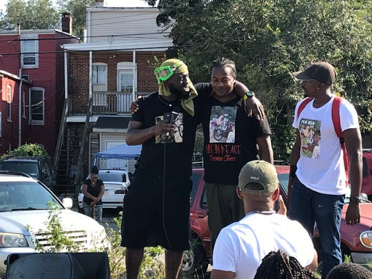"""At a rally Sunday for homicide victims: Raymond """"Breeze"""" Byrd of Pedal 4 Peace, Anthony Jones Jr., father of homicide victim Dezmen Jones and Pedal 4 Peace's Brandt Kingsley."""