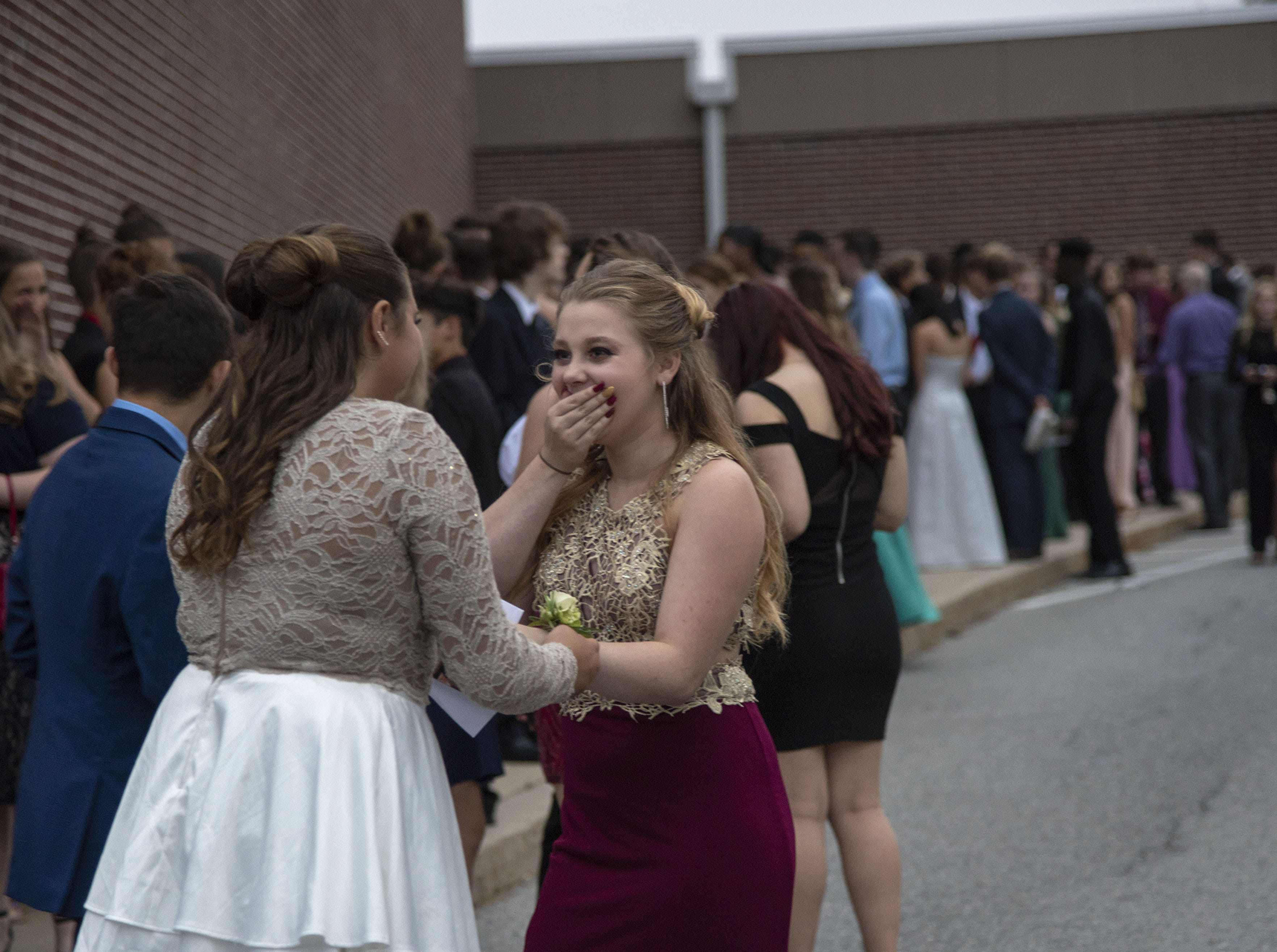 Students line up to go inside for the Dallastown High School homecoming dance on Saturday, October 06, 2018.