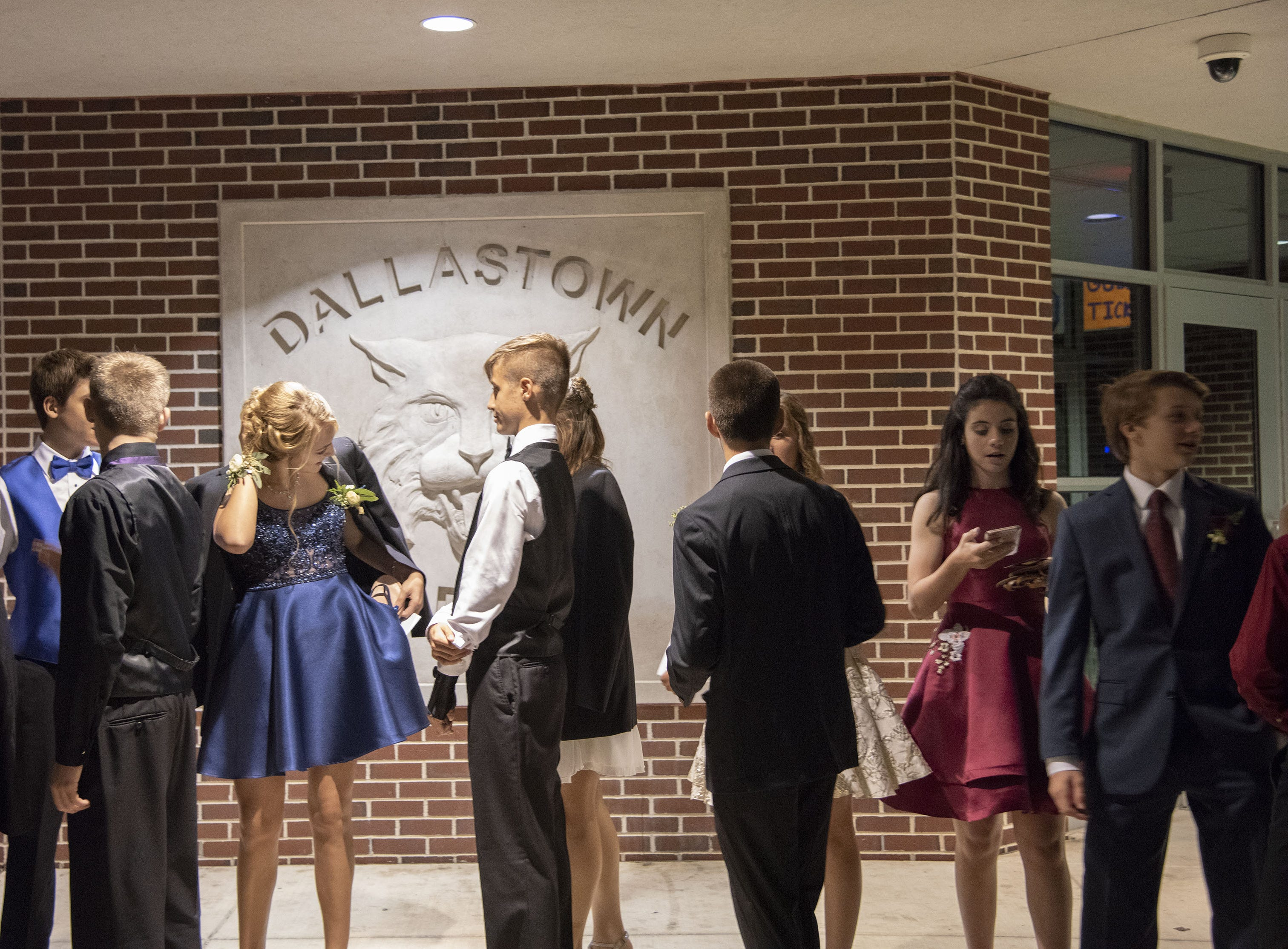 Students wait in line for The Dallastown Area High School homecoming dance that is schedule to start at 7pm on Saturday, October 6, 2018.