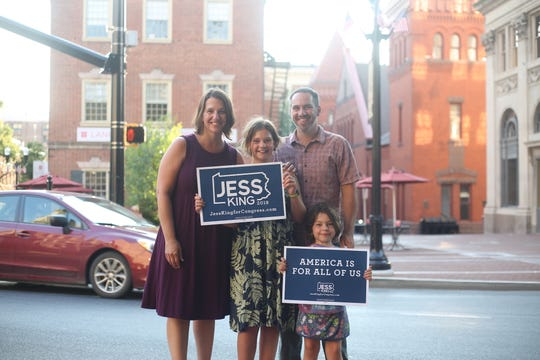 Nonprofit executive Jess King poses with her family in Lancaster. King, a Democrat, is working to unseat Republican incumbent Lloyd Smucker in the newly redrawn 11th congressional district.