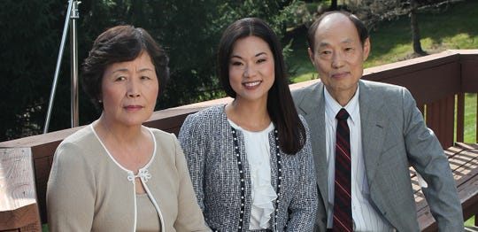 Republican Pearl Kim poses with her parents, who immigrated to the U.S. from South Korea. If Kim wins in the 5th congressional district, she will be the first woman of color in Pennsylvania elected to Congress.